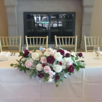 head table flowers in burgundy, blush / light pink and white