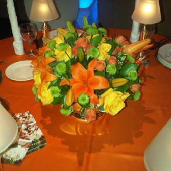 orange asiatic lilies and yellow flowers centerpiece