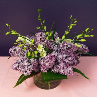 purple lilacs and white dedrobium orchid wedding centerpiece