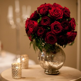 classic red roses in elegant red vase