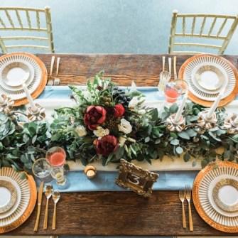 table centerpiece, plus eucalyptus garland runner
