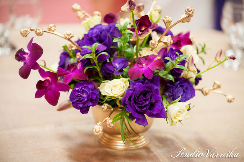 Wedding Centerpieces 034 Purple Orchid Centerpiece With Mixed Greenery In A Square Gl Vase Accented Black River Rocks