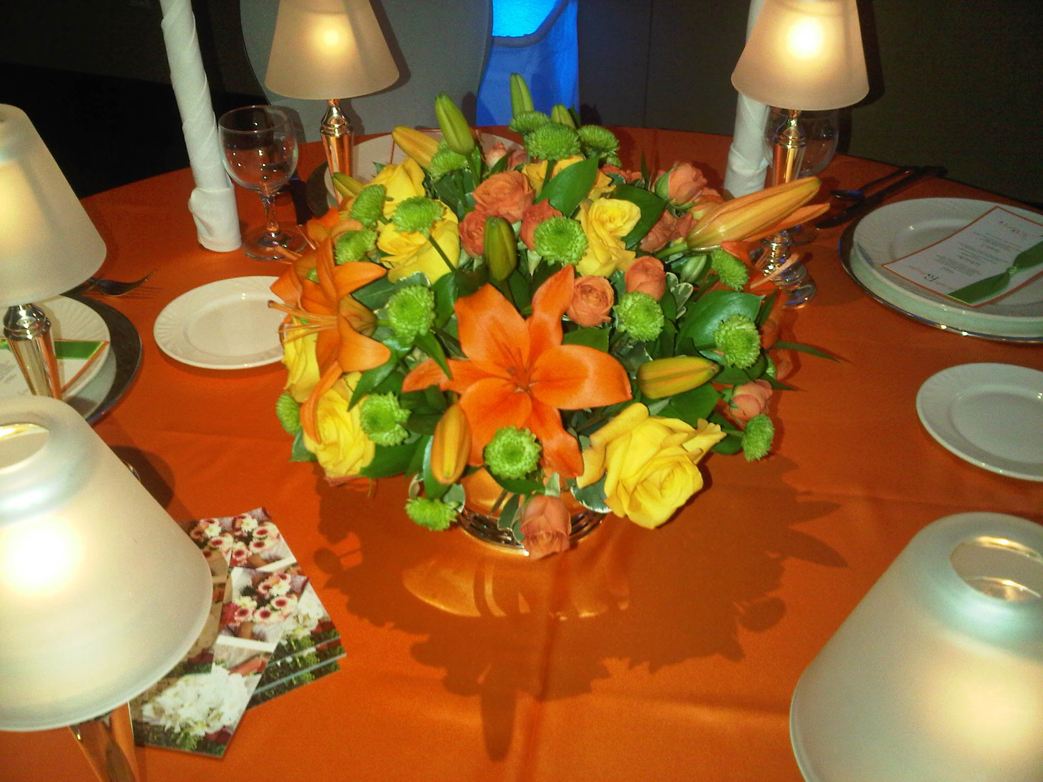 Flower arrangements gallery floral sunshine orange asiatic lilies and yellow flowers centerpiece mightylinksfo