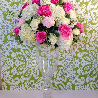 ceremony flowers atop clear glass curvy vase