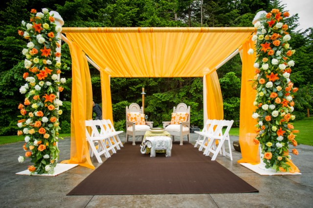 Indian wedding mandap decorated in orange & white