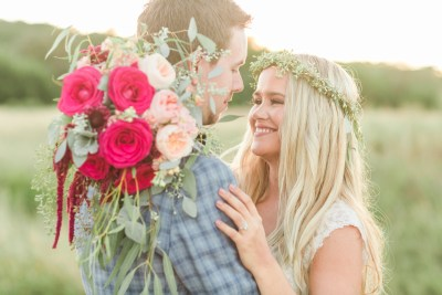 smiling bride and groom with bridal bouquet