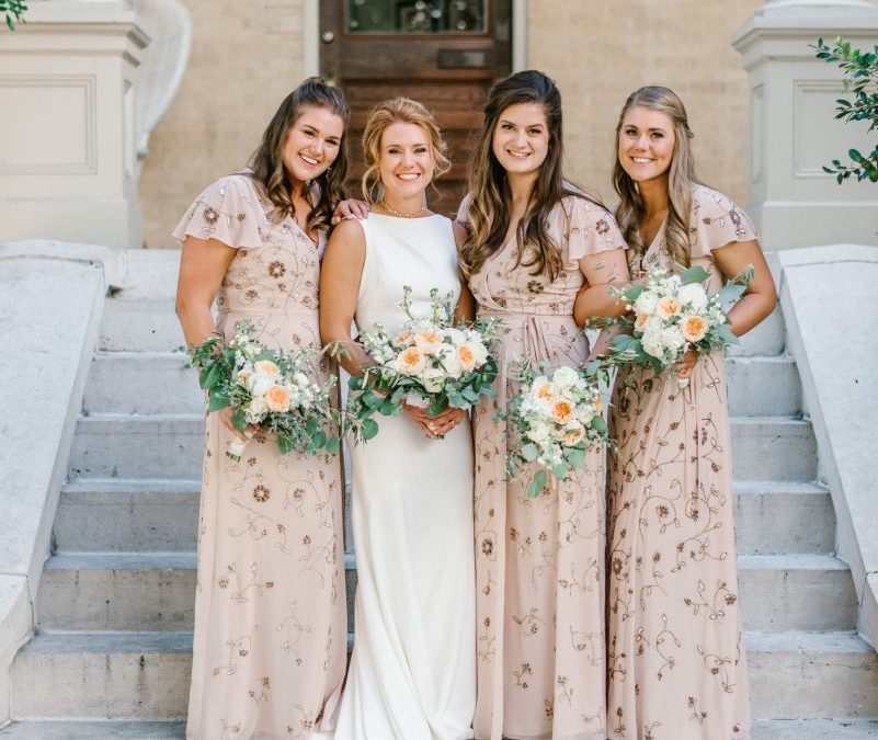 bride and bridesmaids in fall dresses