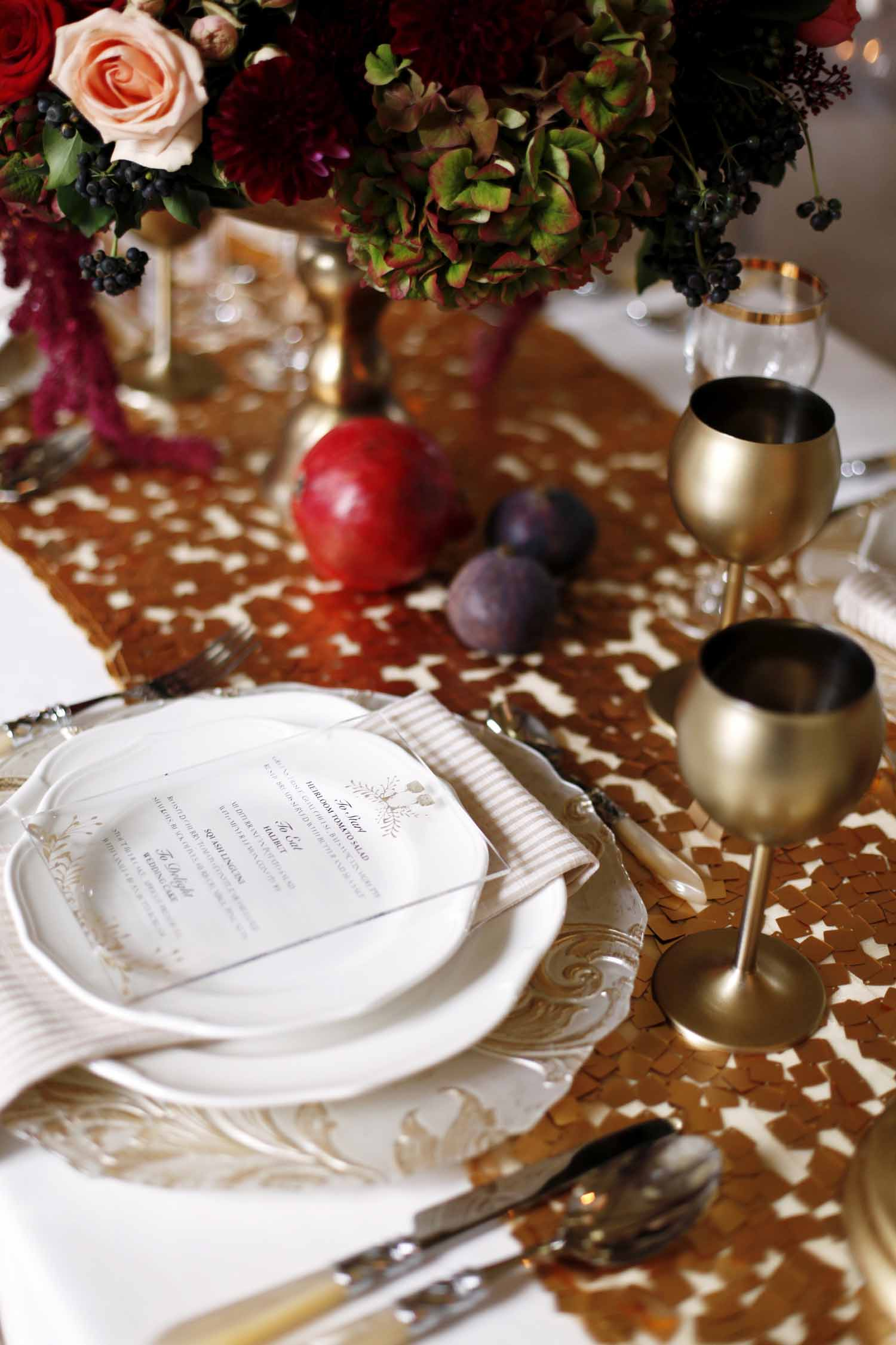 Elegant place setting with gold rimmed plates, gold water goblet, lucite menu card for Wedding Style Shoot in Kloster Eberbach, Germany, designed by Flora Nova Design, Seattle