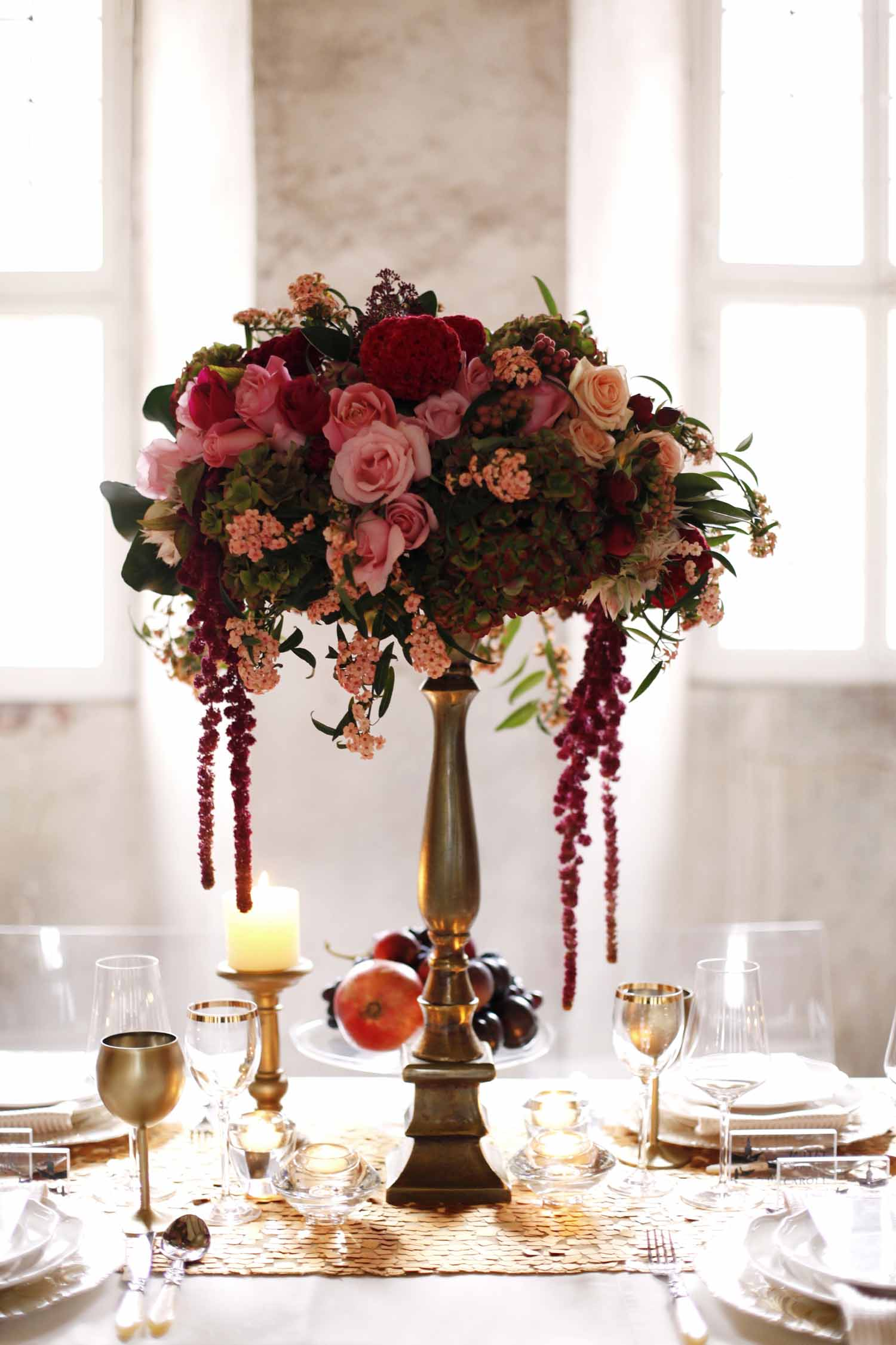 tall centerpiece of red and blush flowers on gold stand for Wedding Style Shoot in Kloster Eberbach, Germany, designed by Flora Nova Design, Seattle