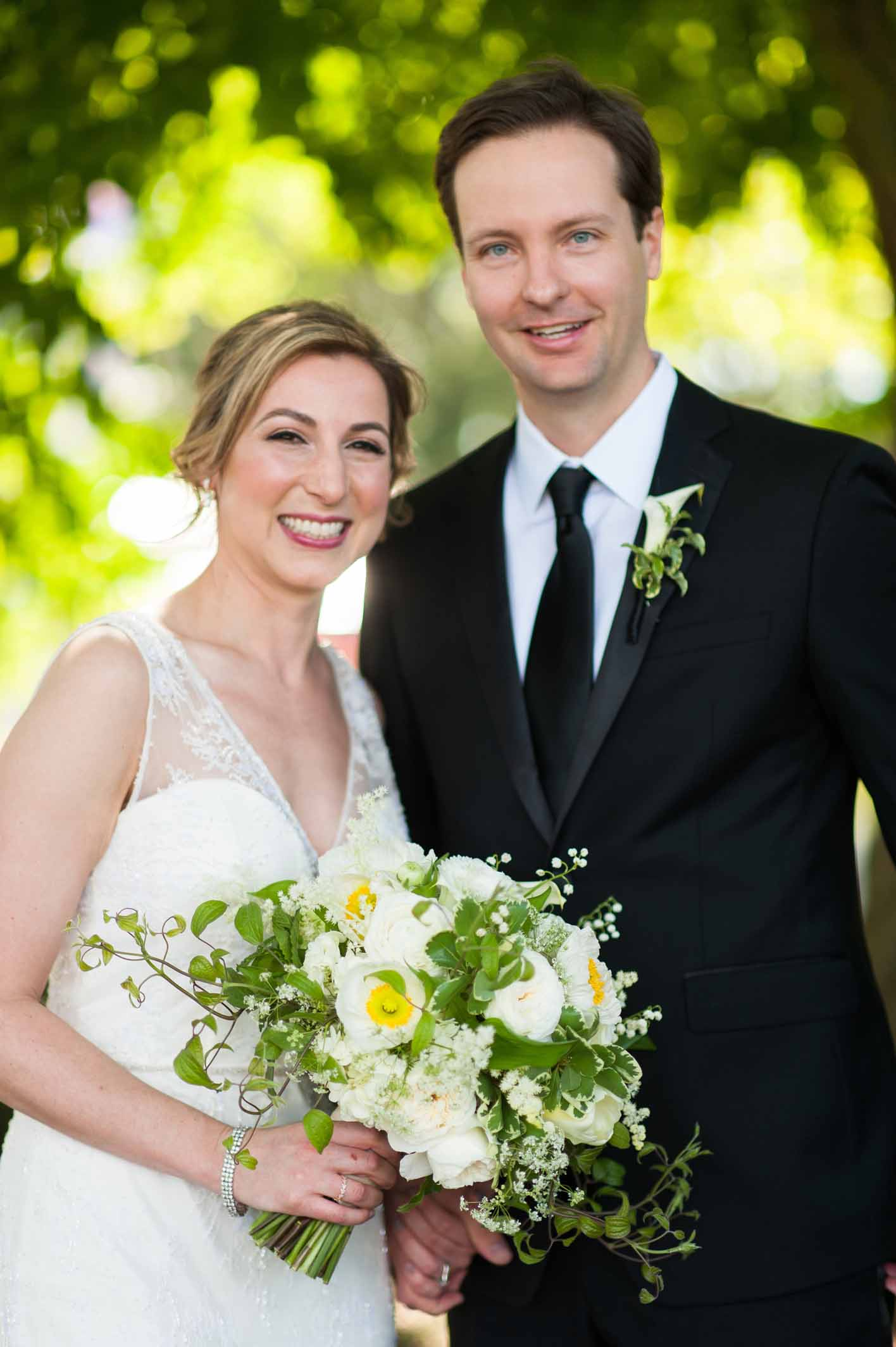 Elissa and upshur, wedding couple at spring wedding, with bouquet of white and yellow spring flowers - designed by Flora Nova Design