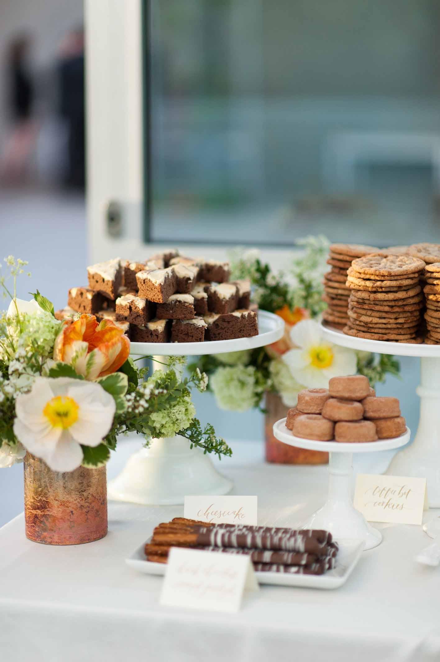 Floral decor on dessert table at spring wedding