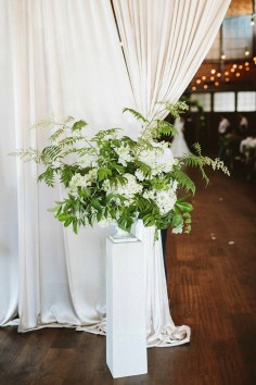 large greenery floral piece at wedding ceremony entrance