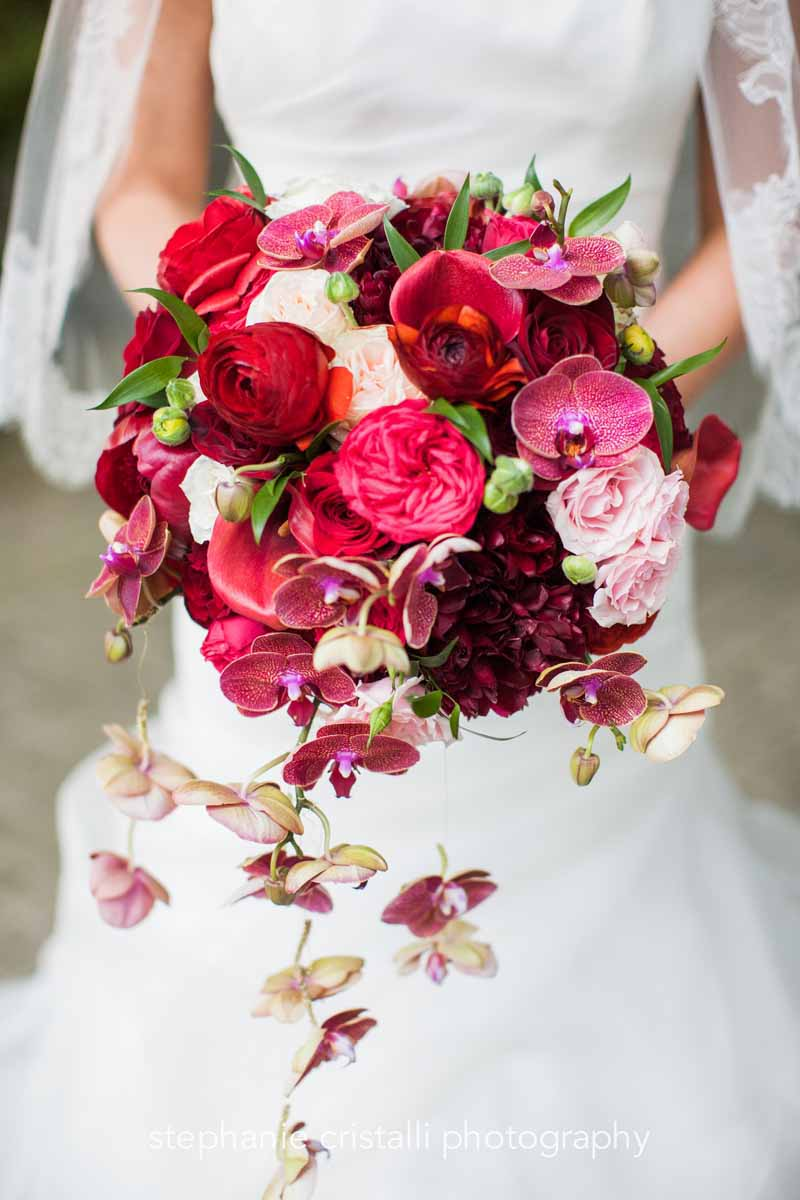 Modern bouquet of red and pink garden roses and trailing orchids - Flora Nova Design Seattle