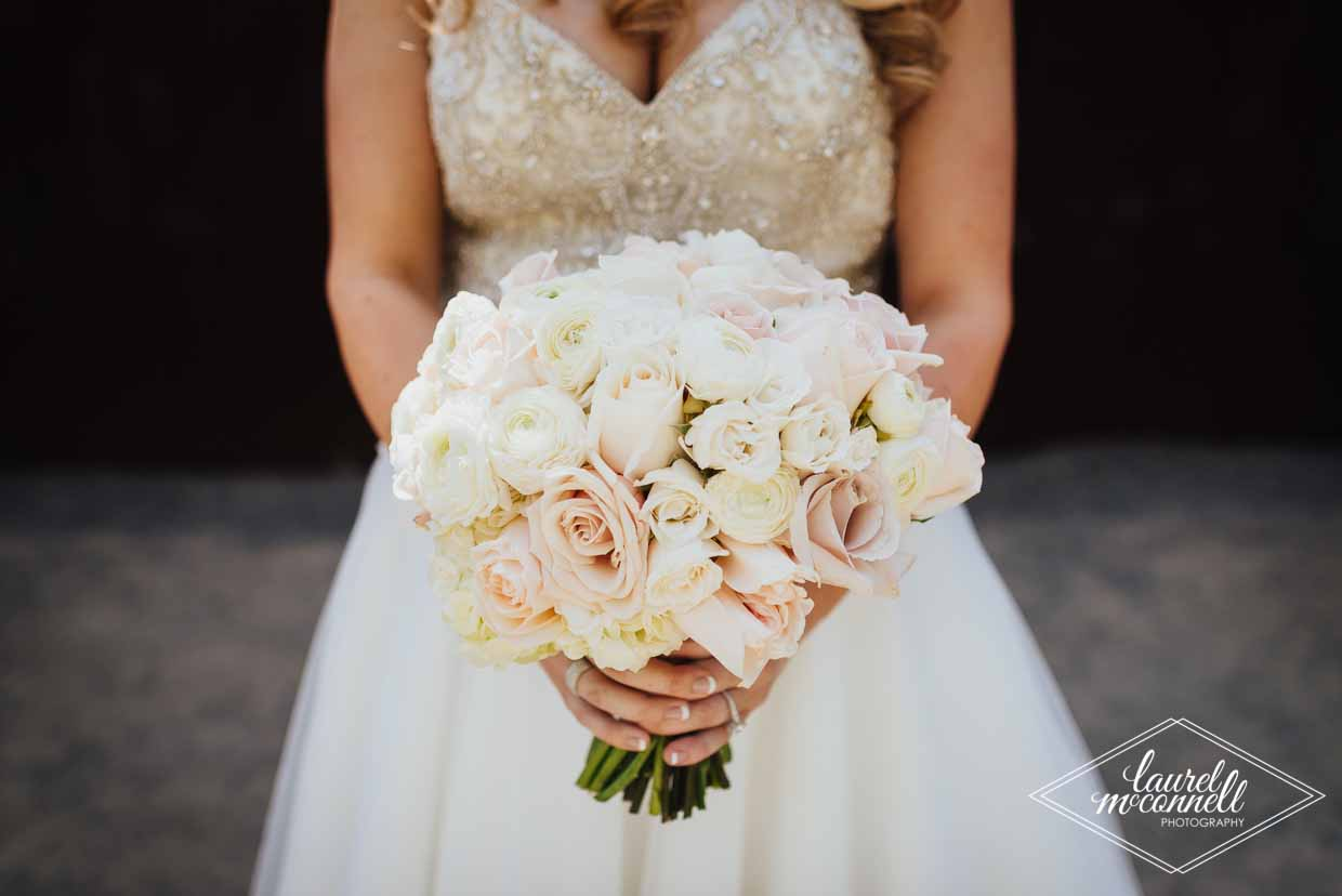 Rounded, tight bridal bouquet of pink and blush colored garden roses, roses, spray roses, calla lilies - Bridal Bouquet Pricing by Flora Nova Design Seattle