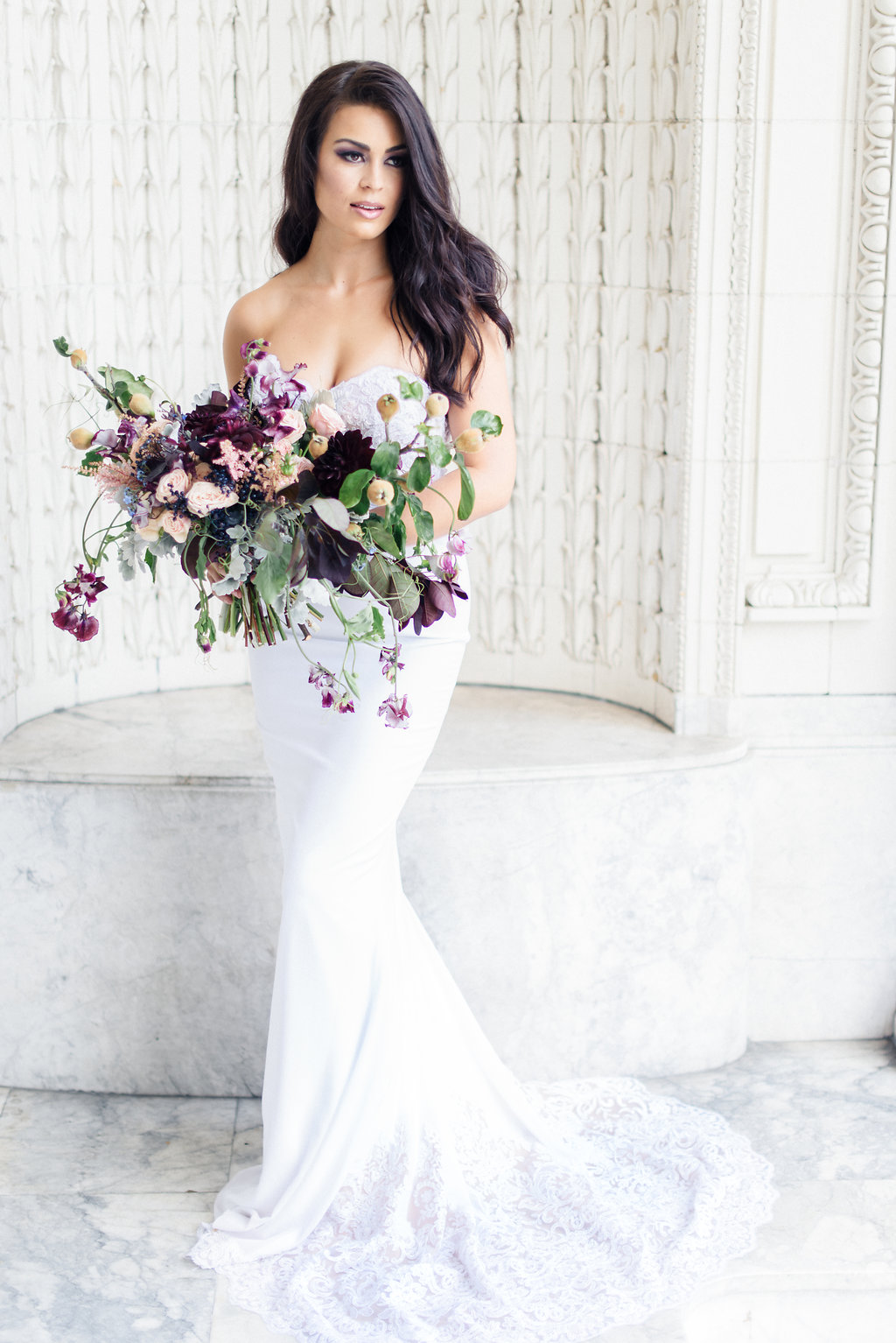 Wild, overgrown bridal bouquet of purple roses, blooming clematis vines, lavender roses, peonies - Bridal Bouquet Shapes designed by Flora Nova Design