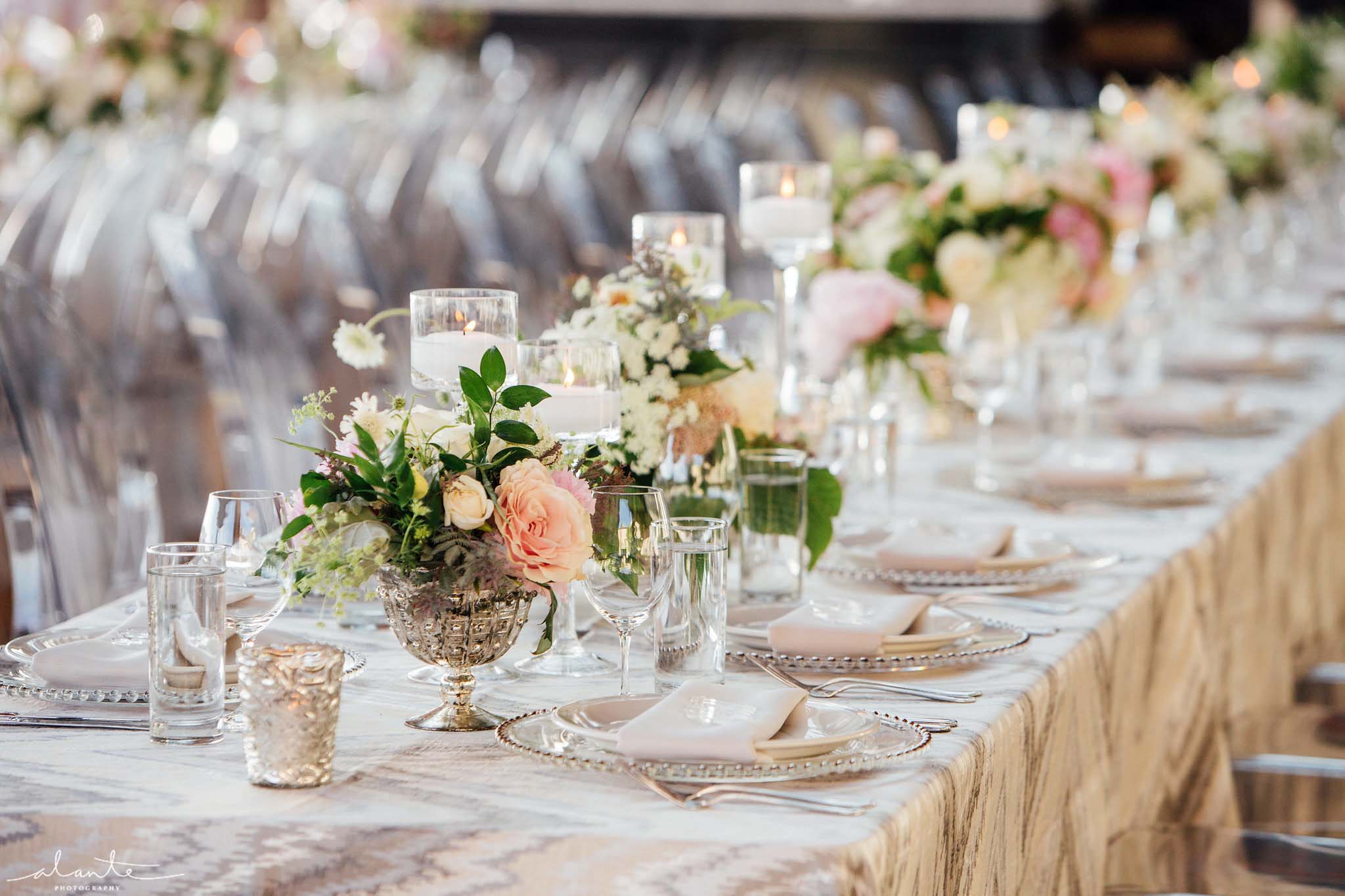 Long table lined with flowers and candles - Olympic Rooftop Pavilion wedding with pink peonies by Flora Nova Design Seattle