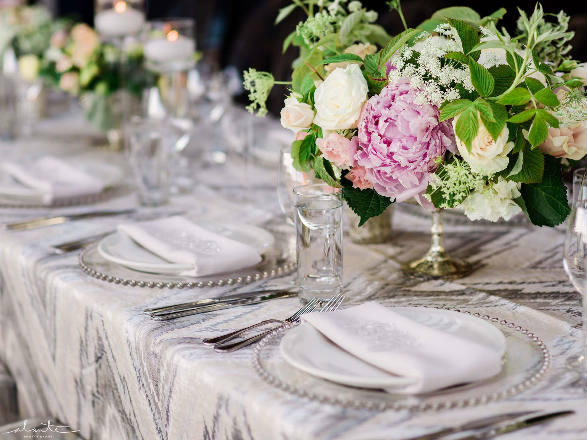 Pink peony centerpiece in silver compote, Olympic Rooftop Pavilion wedding with pink peonies by Flora Nova Design Seattle
