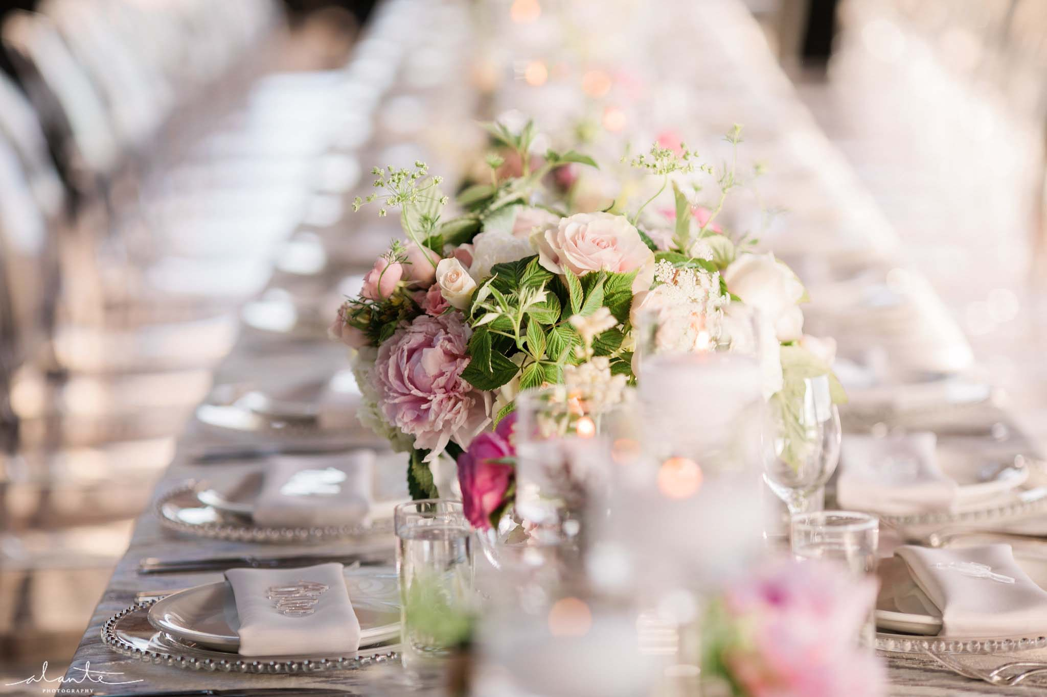 Long table filled with flowers and candles - Olympic Rooftop Pavilion wedding with pink peonies by Flora Nova Design Seattle