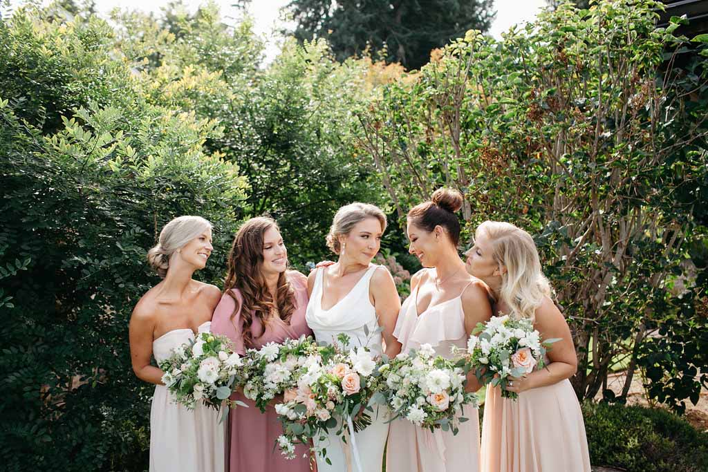 Bride and bride's maids in blush and rose colored dresses - Elegant Seattle Garden Wedding by Flora Nova Design Seattle