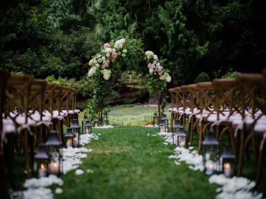 Wedding arch and wedding aisle - A Luxe Chateau Lill Wedding designed by Flora Nova Design Seattle