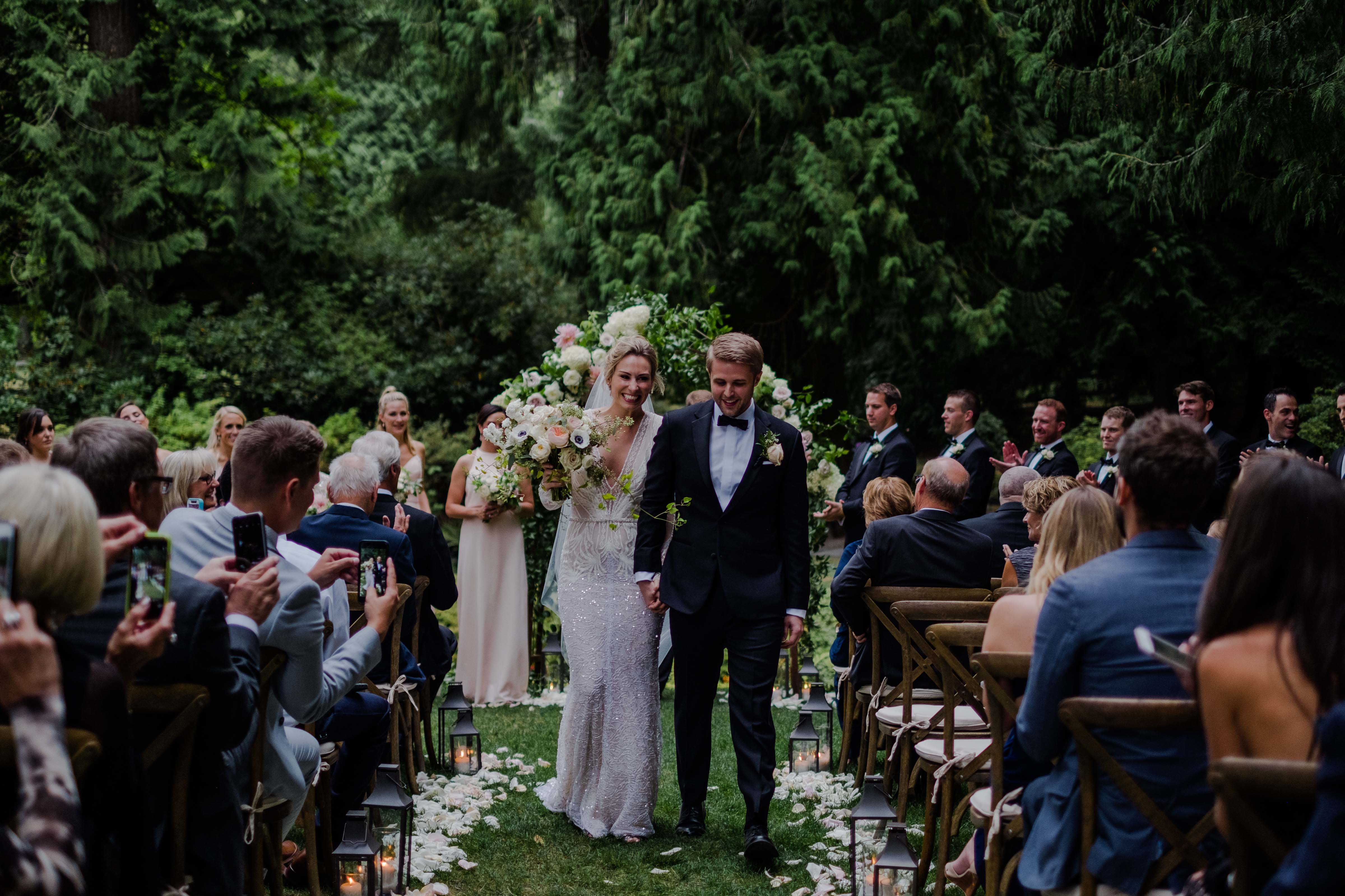bride and groom walking down the aisle, just married - A Luxe Chateau Lill Wedding designed by Flora Nova Design Seattle