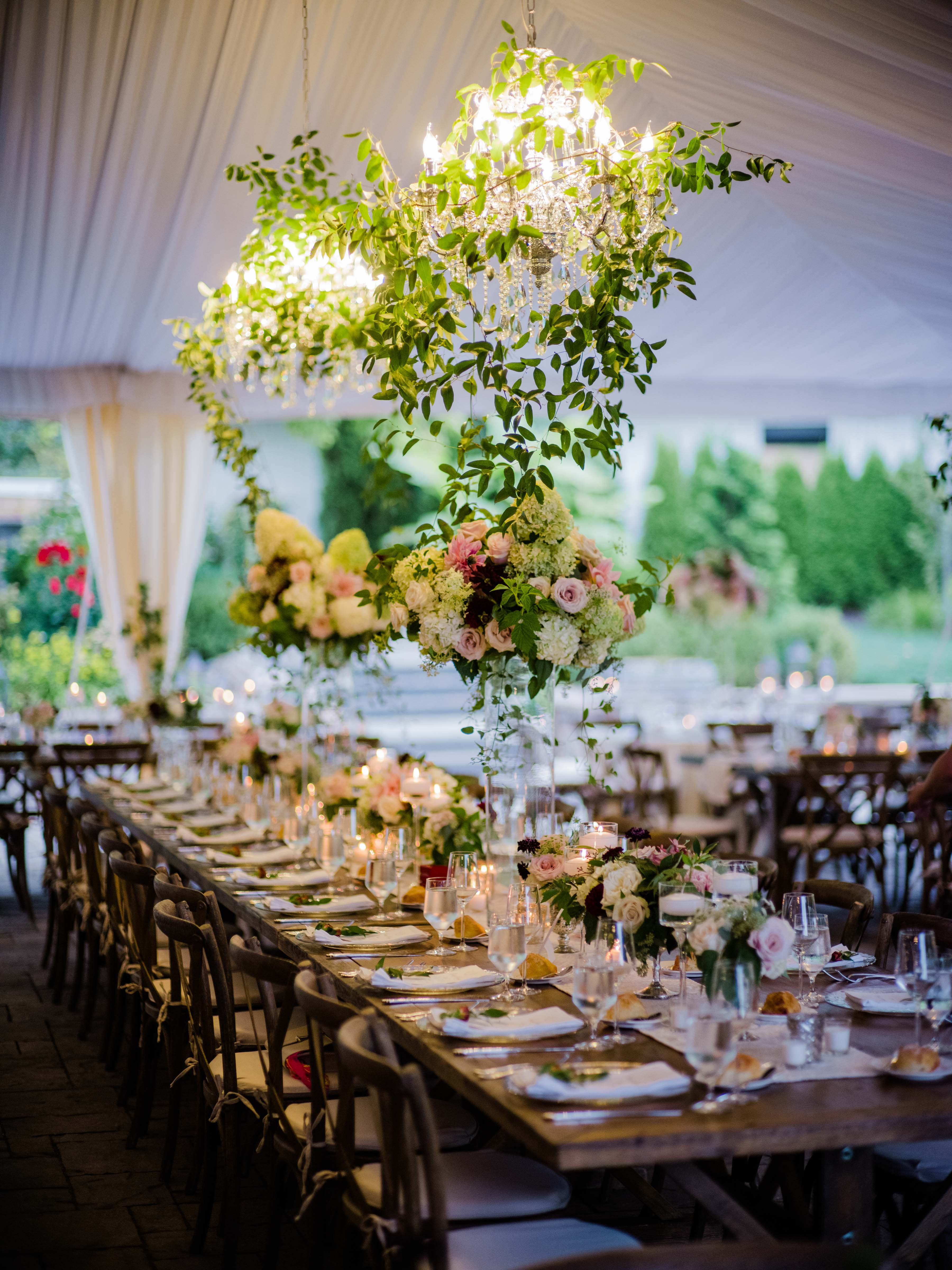 wedding head table with flower centerpieces