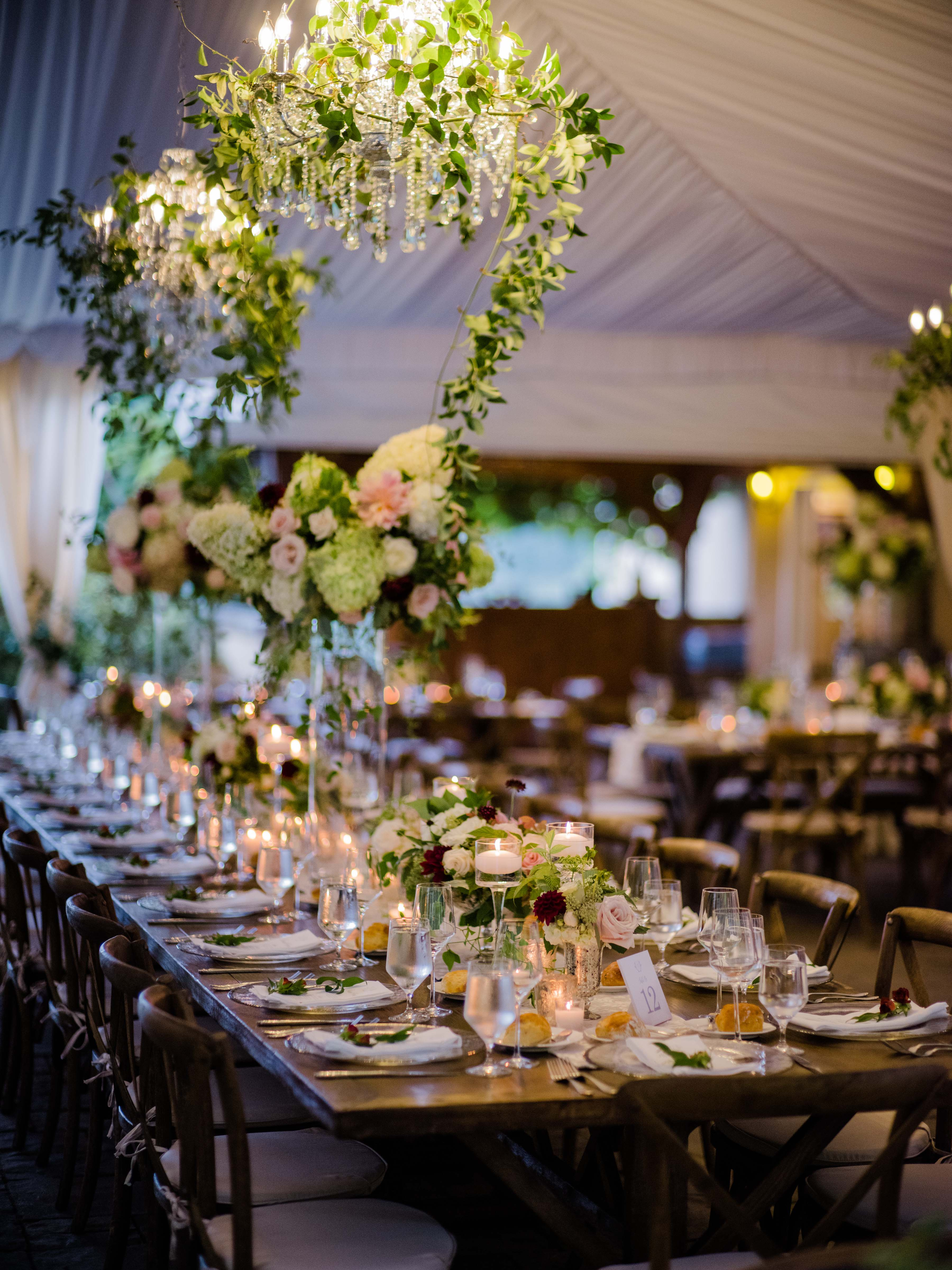 long wooden table with flower centerpieces
