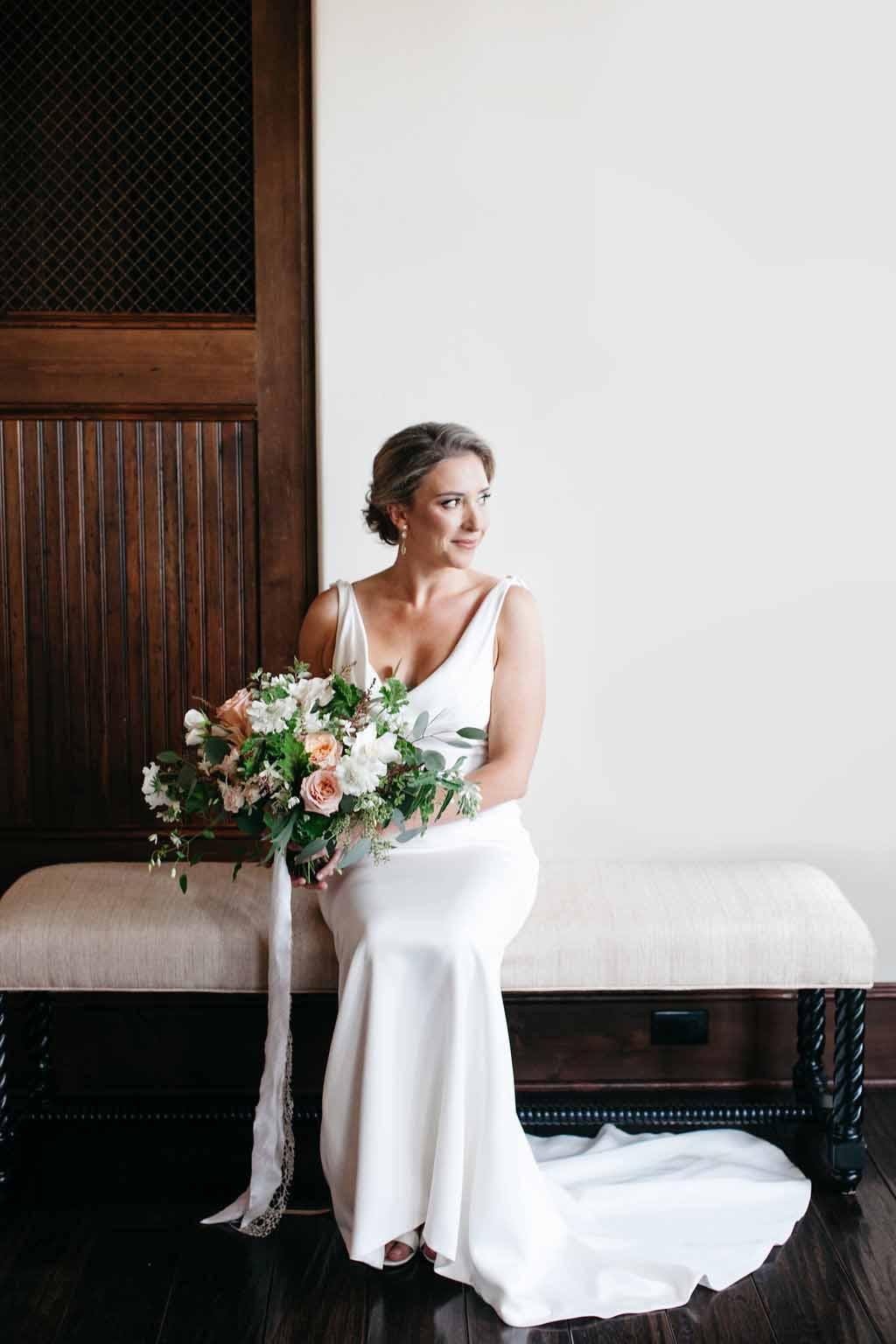 Bride holding her bouquet of garden fall flowers - Elegant Seattle Garden Wedding by Flora Nova Design Seattle