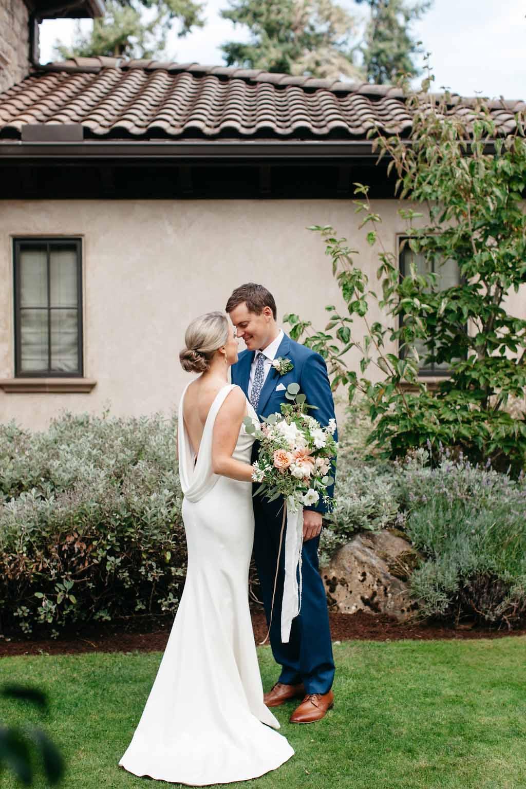 Bride and groom at their garden wedding - designed by Flora Nova Design Seattle