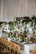 floral chandeliers hanging from tent ceiling