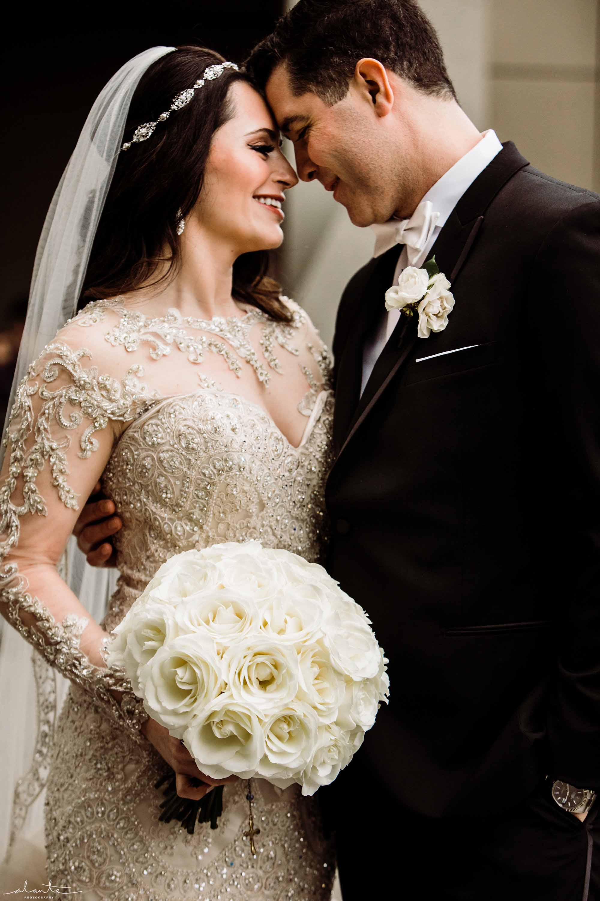 Bride and groom with bouquet of all white roses - Luxury Winter Wedding at the Four Seasons by Flora Nova Design Seattle