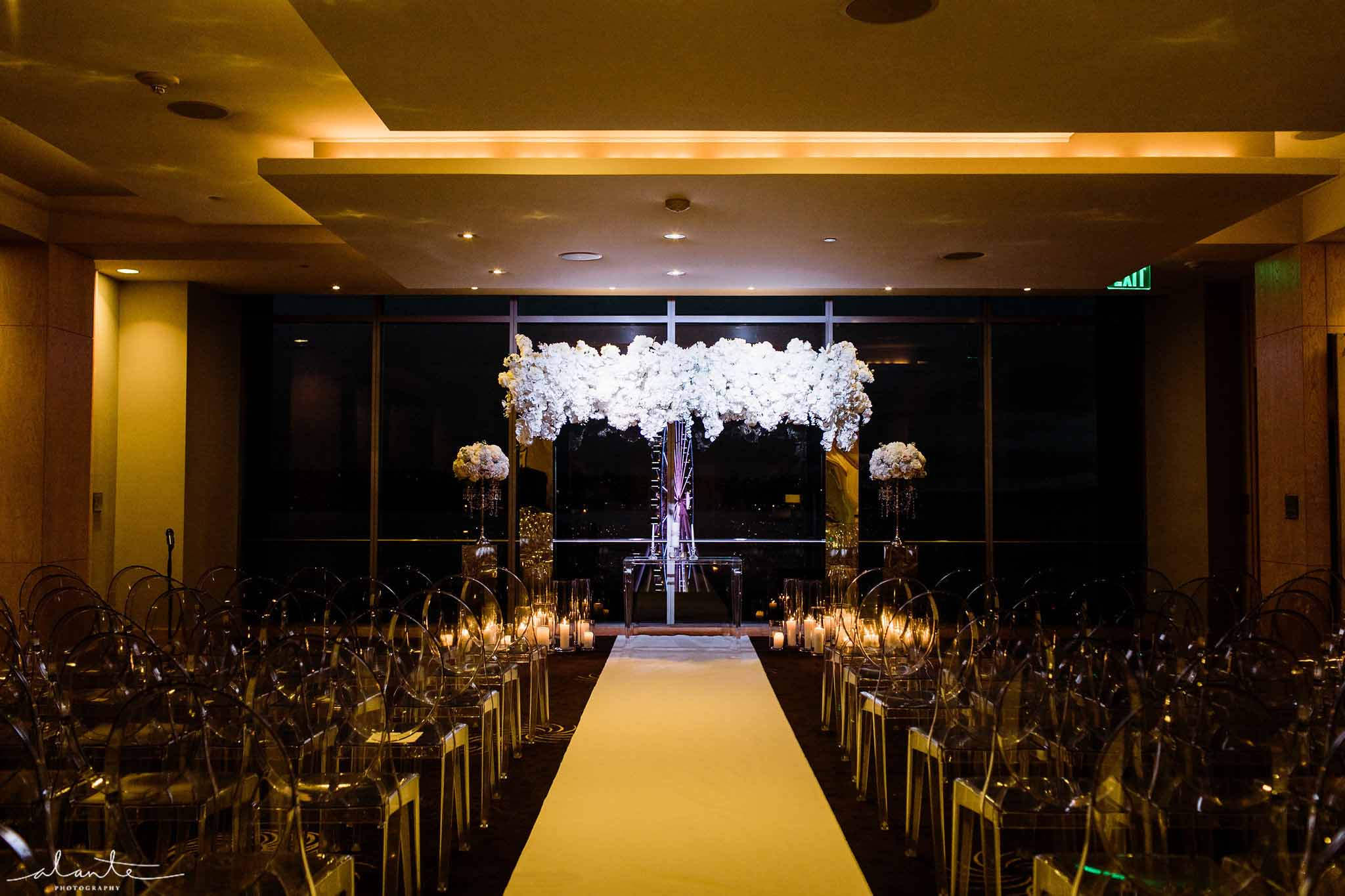 Winter wedding ceremony aisle with orchid wedding arch - Luxury Winter Wedding at the Four Seasons by Flora Nova Design Seattle