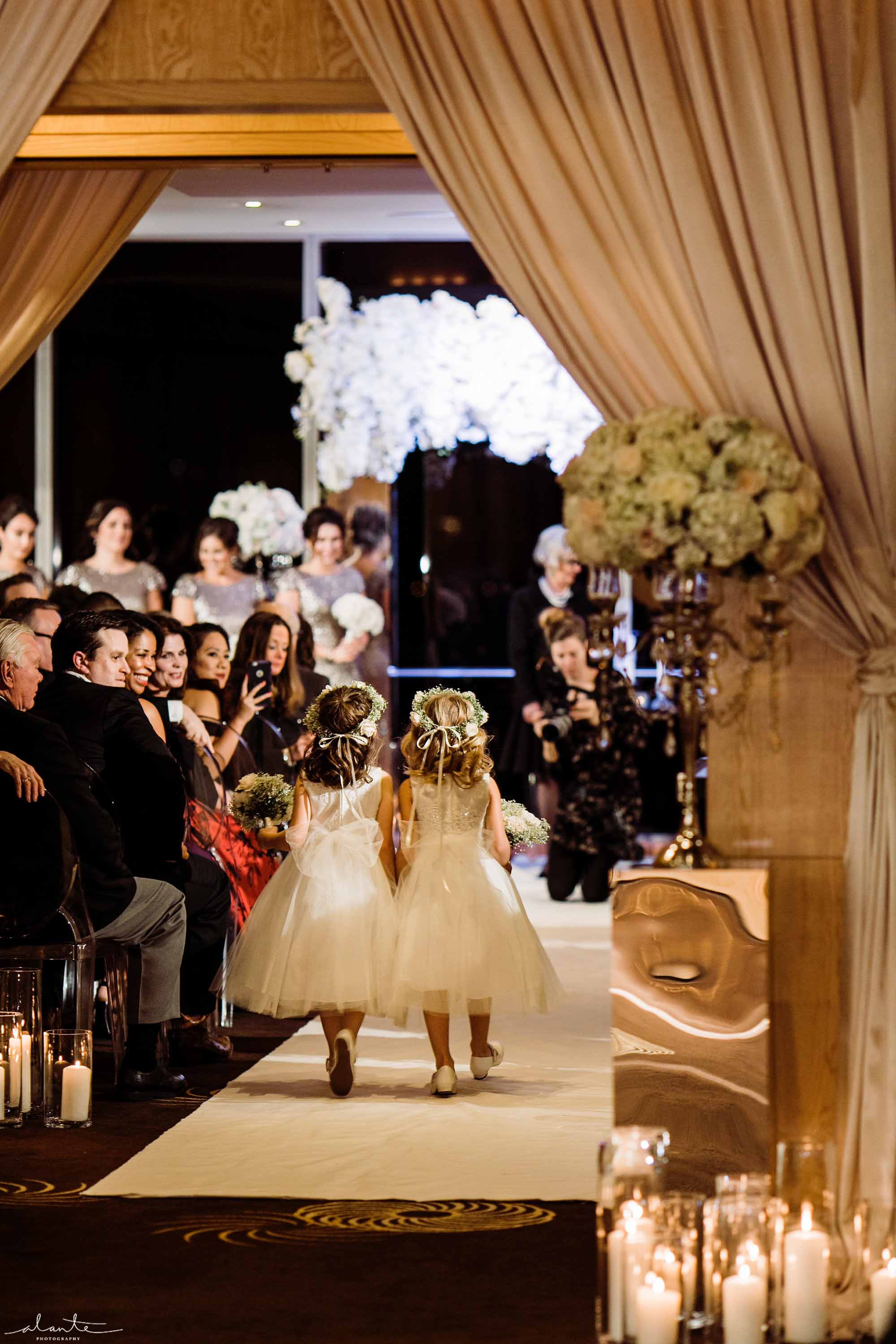 Wedding ceremony with two flower girls walking down aisle - Luxury Winter Wedding at the Four Seasons by Flora Nova Design Seattle