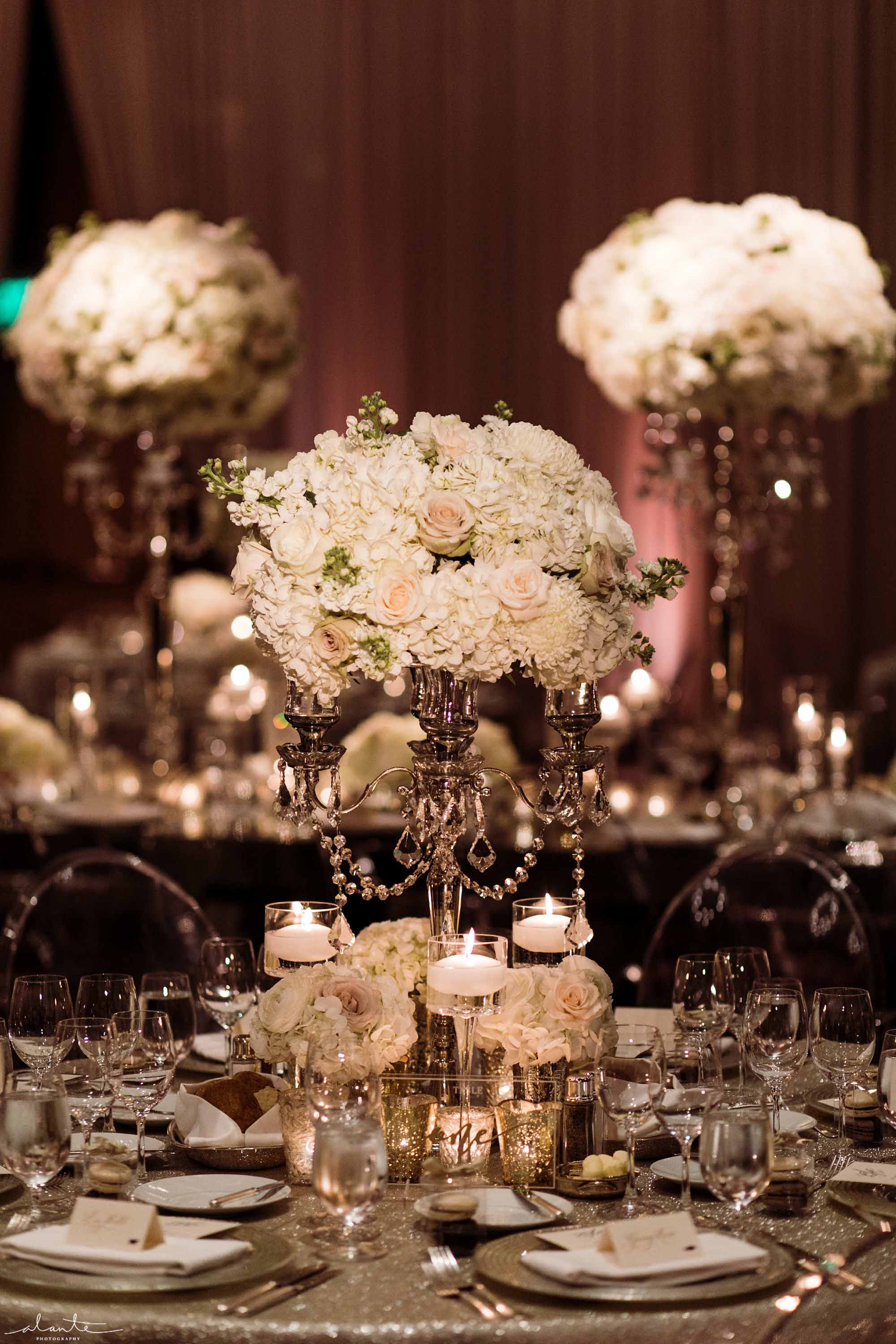 Elevated white floral centerpieces with crystal accents - Luxury Winter Wedding at the Four Seasons by Flora Nova Design Seattle