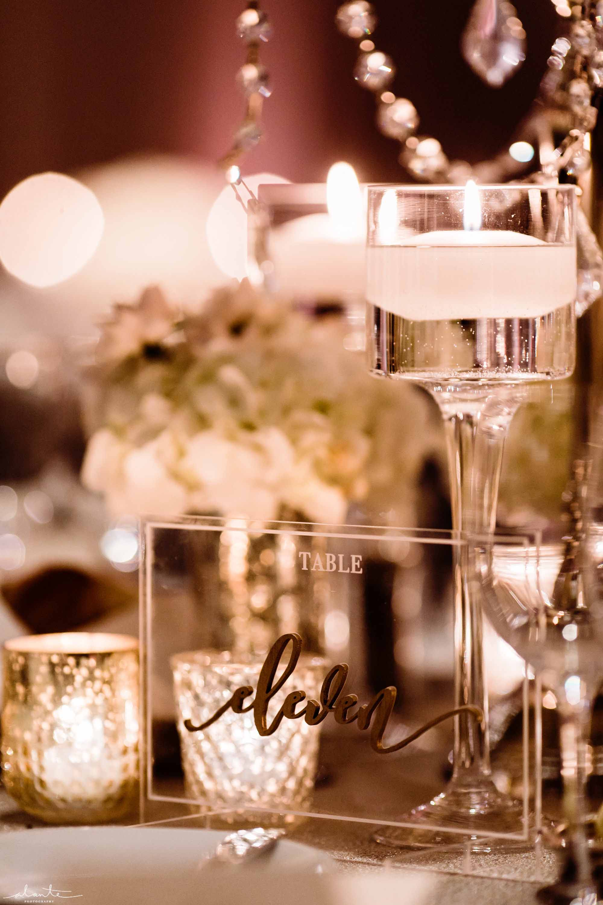 Floating candles and votive candles and lucite table number - Luxury Winter Wedding at the Four Seasons by Flora Nova Design Seattle
