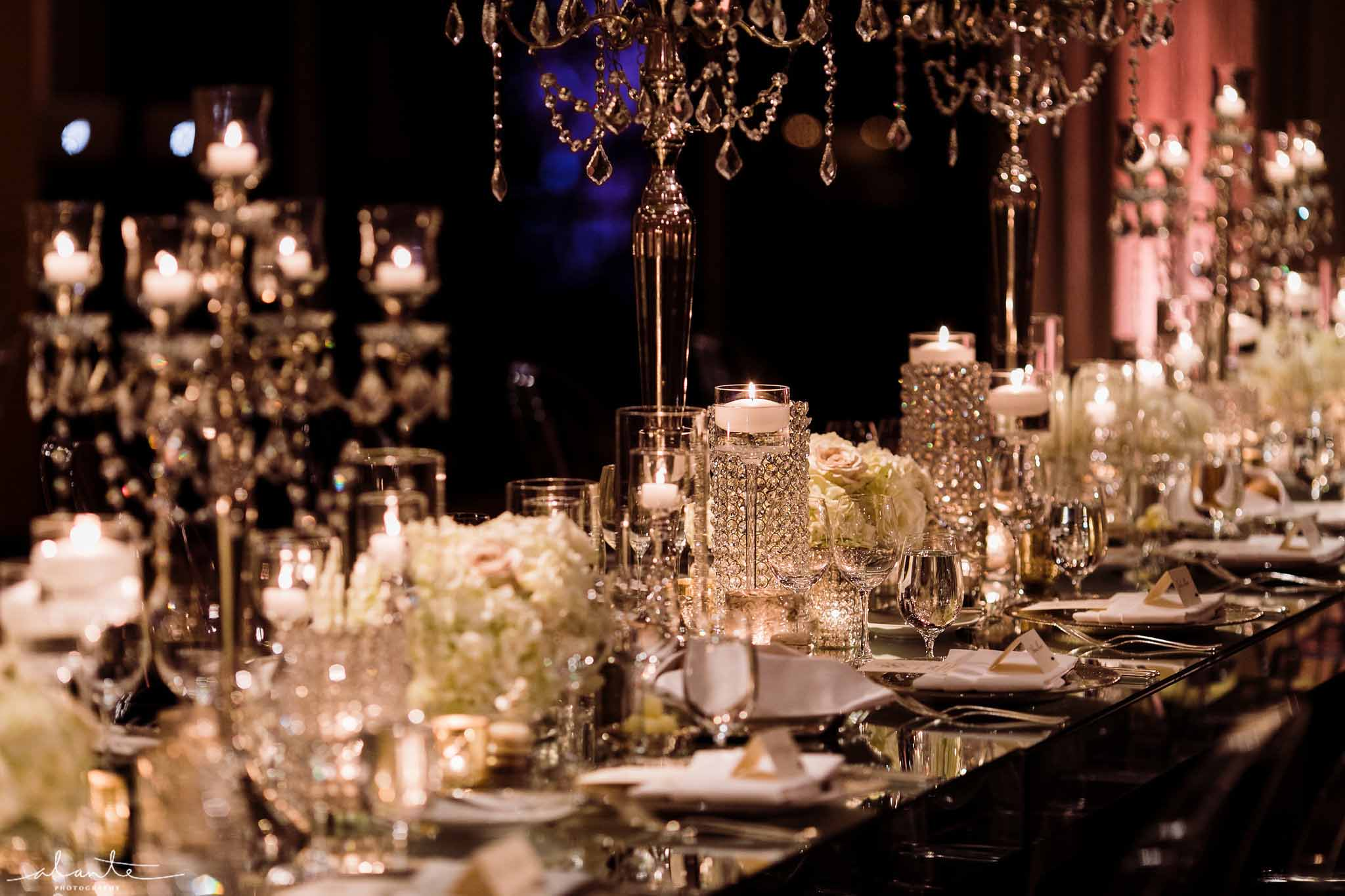 Elegant white wedding reception table with candles and white centerpieces and crystal candelabras - Luxury Winter Wedding at the Four Seasons by Flora Nova Design Seattle