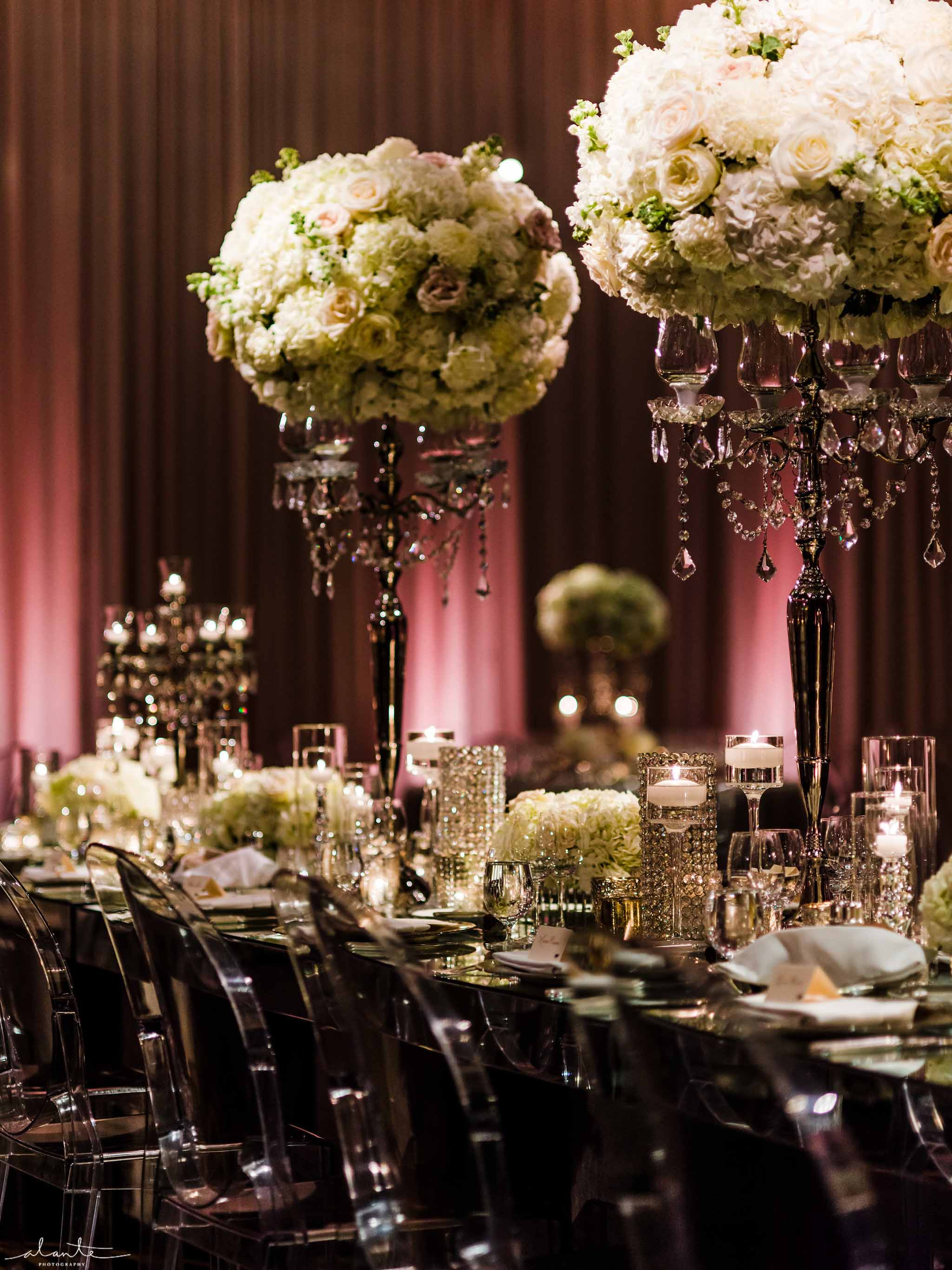 Tall, white floral centerpieces in wedding head table - Luxury Winter Wedding at the Four Seasons by Flora Nova Design Seattle
