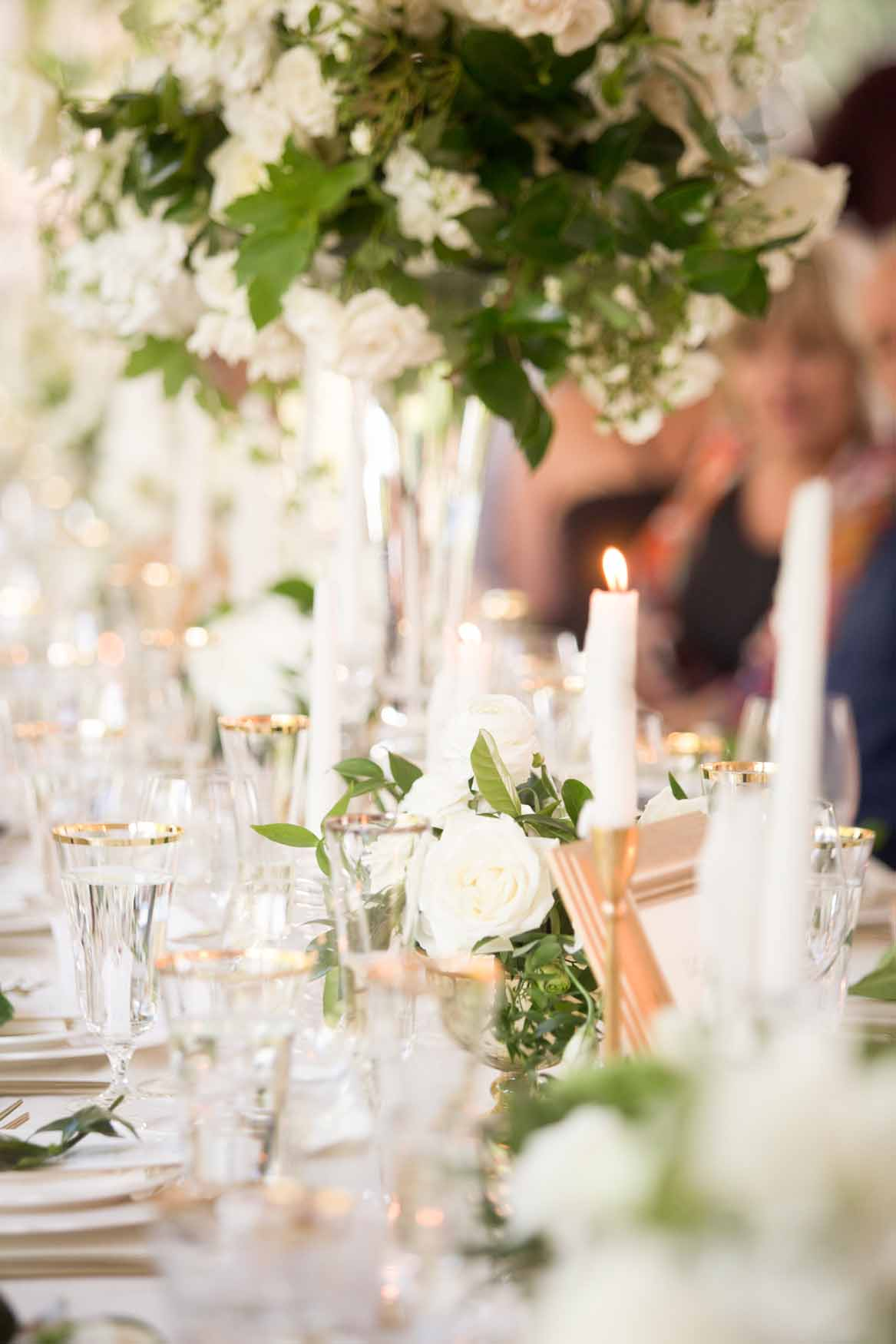 A head table willed with white centerpieces and candles - Elegant Summer Private Estate Wedding. Flora Nova Design Seattle