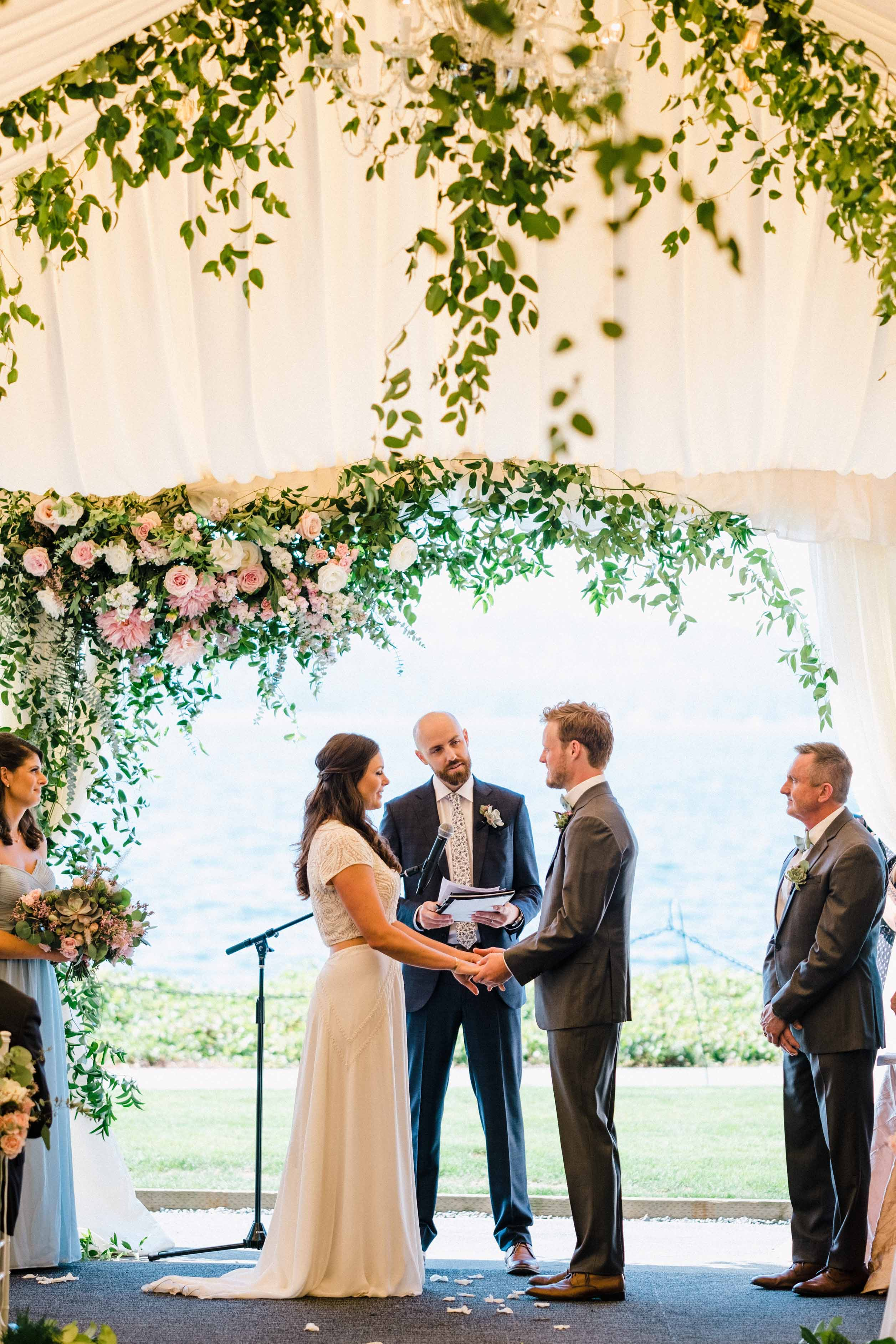 Couple during their wedding ceremony - Woodmark Hotel Wedding by Flora Nova Design Seattle