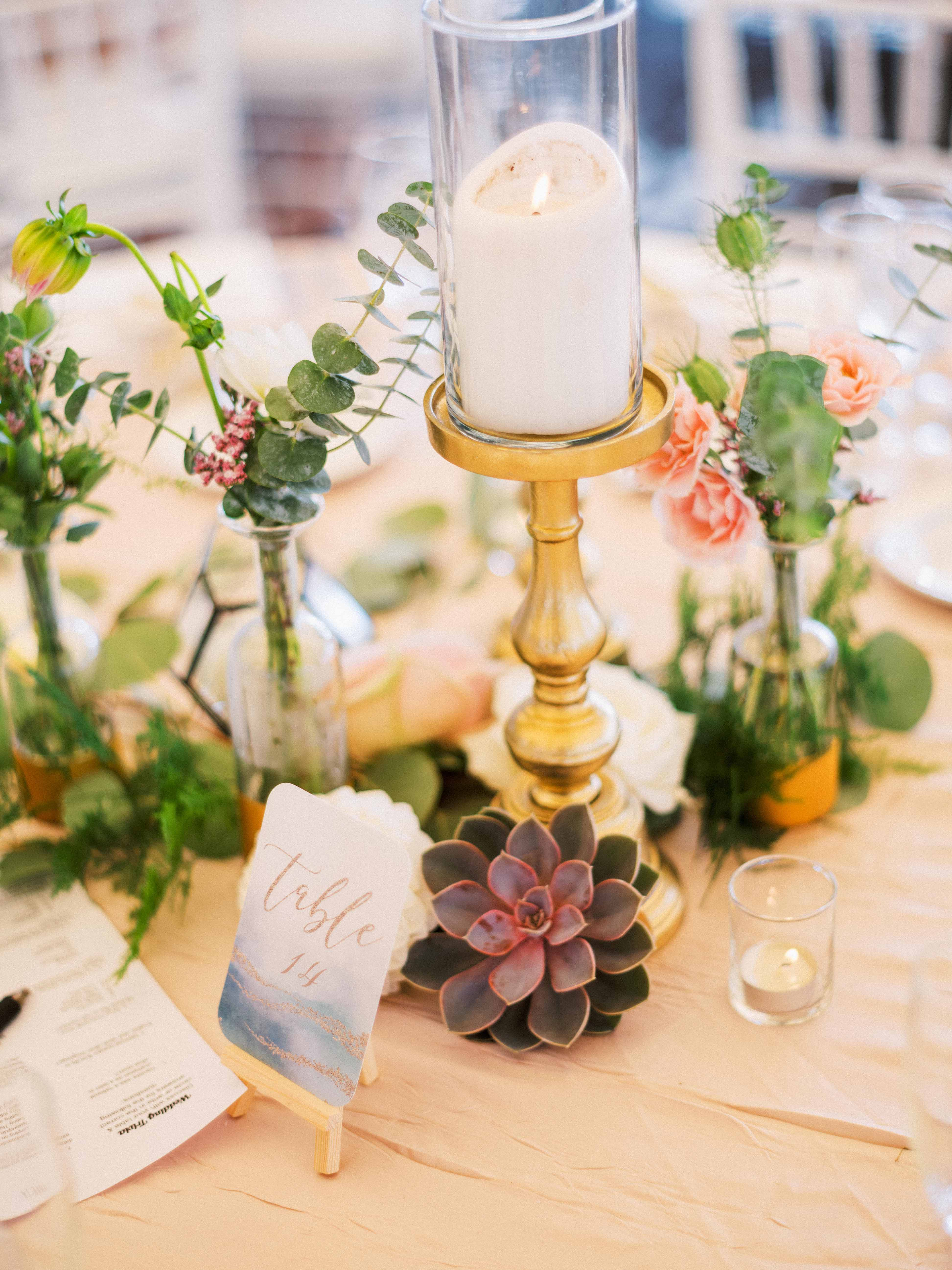 Centerpiece with candles and succulents - Woodmark Hotel Wedding by Flora Nova Design Seattle