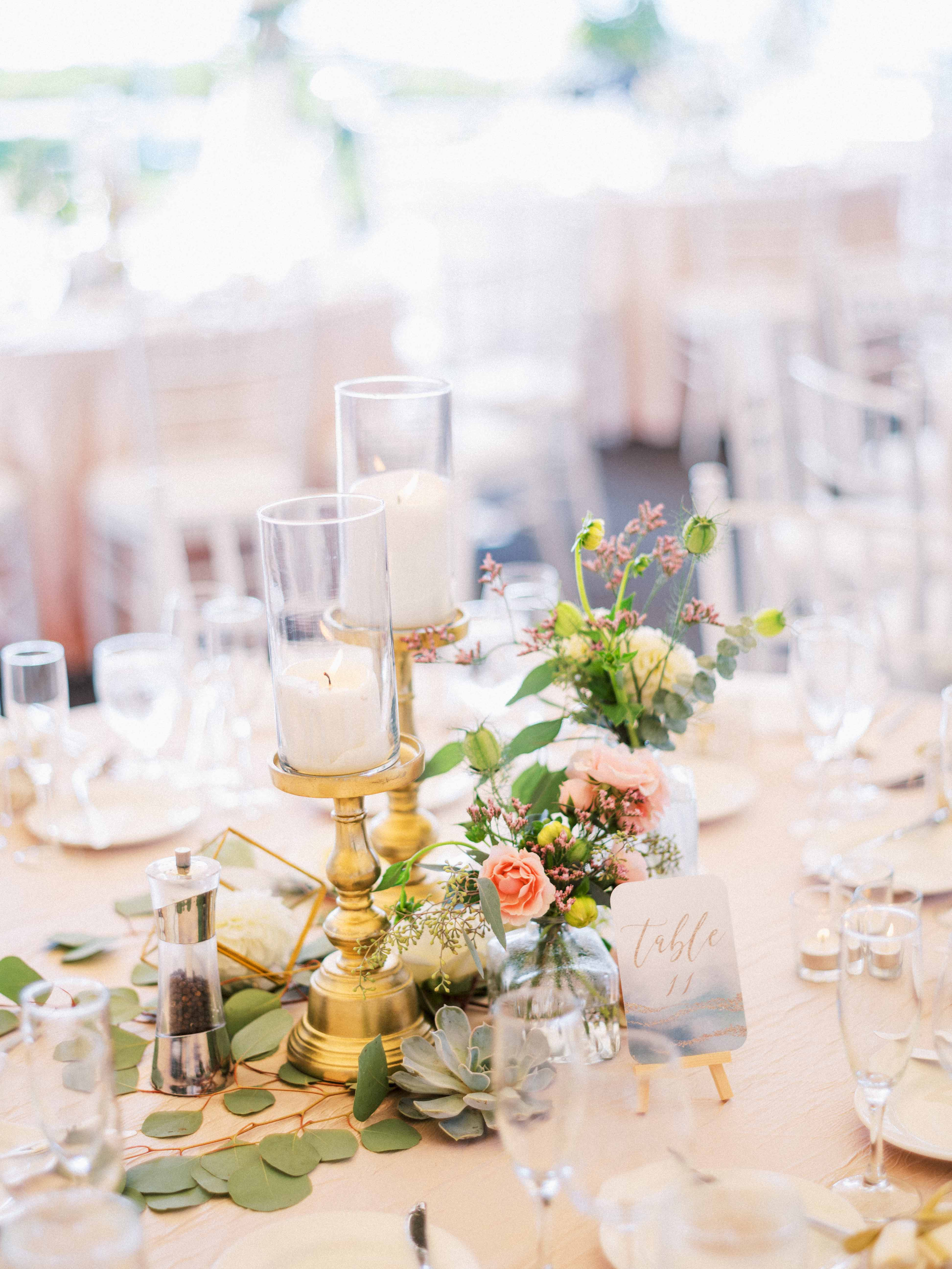 Centerpiece of candles, greenery, blooms - Woodmark Hotel Wedding by Flora Nova Design Seattle