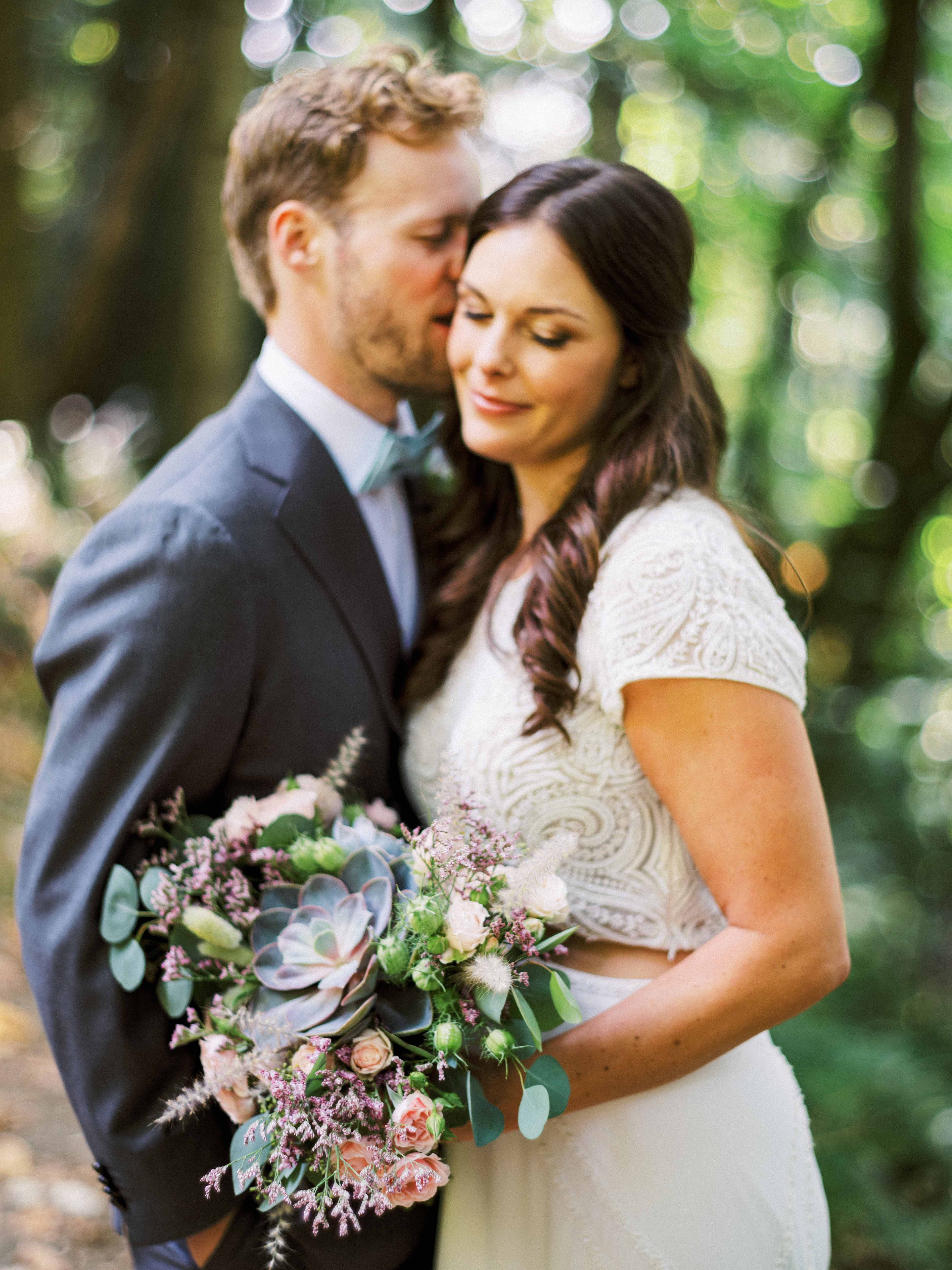 Bride and groom with succulent bouquet - Woodmark Hotel Wedding by Flora Nova Design Seattle