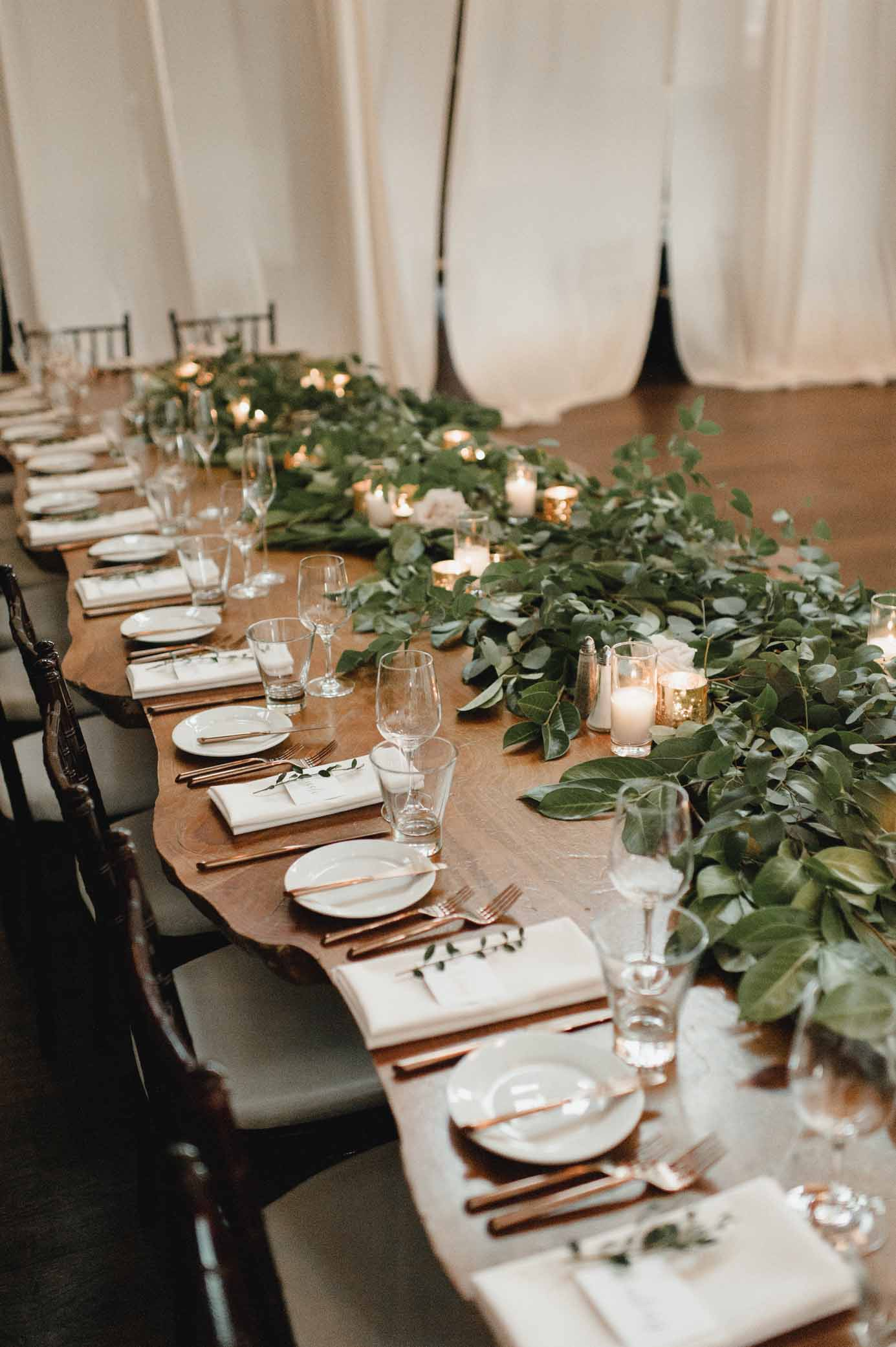 Wedding head table with greenery runner and candles, for romantic greenery wedding in Seattle - Flora Nova Design