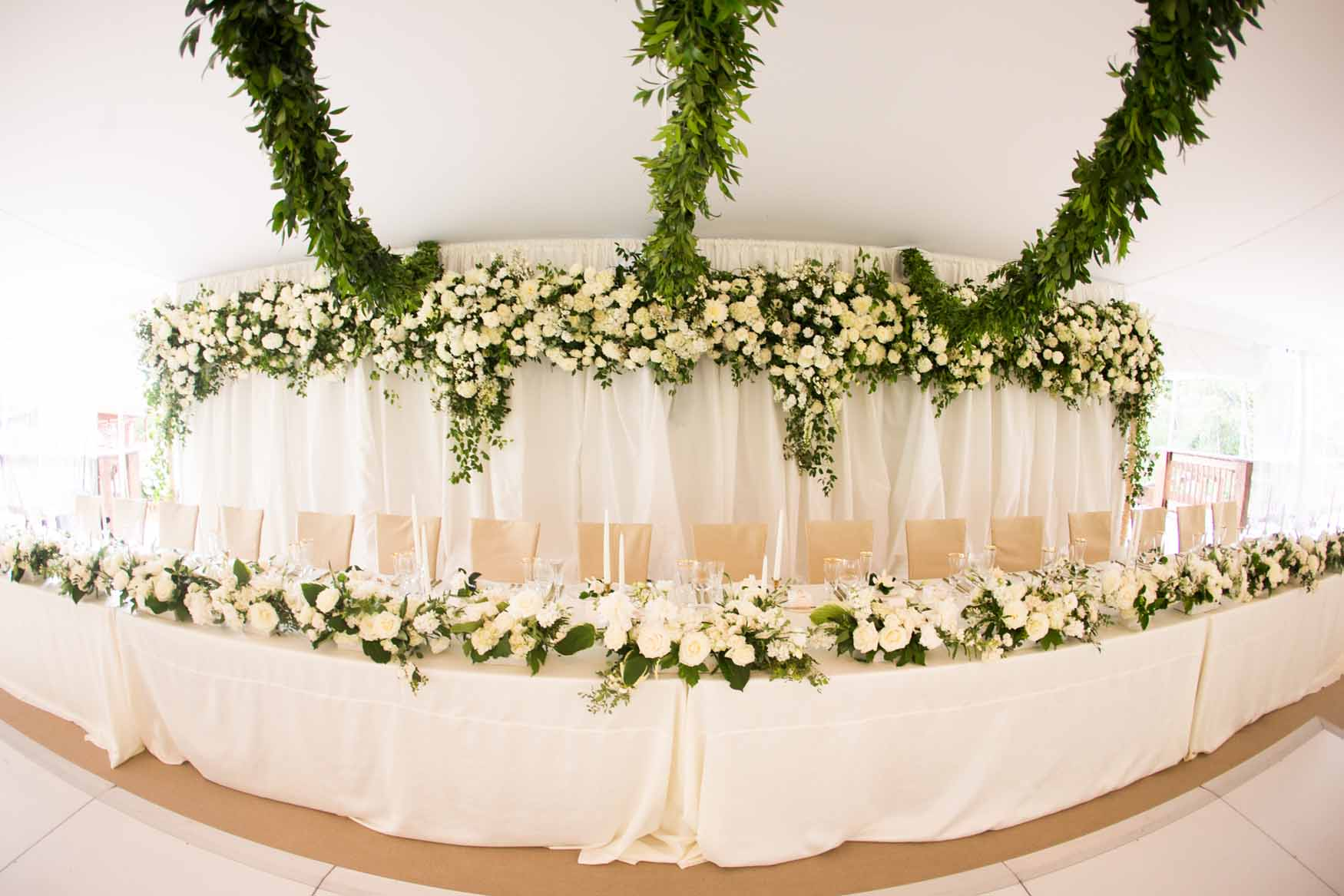 A flower wall behind the head table - Elegant Summer Private Estate Wedding. Flora Nova Design Seattle