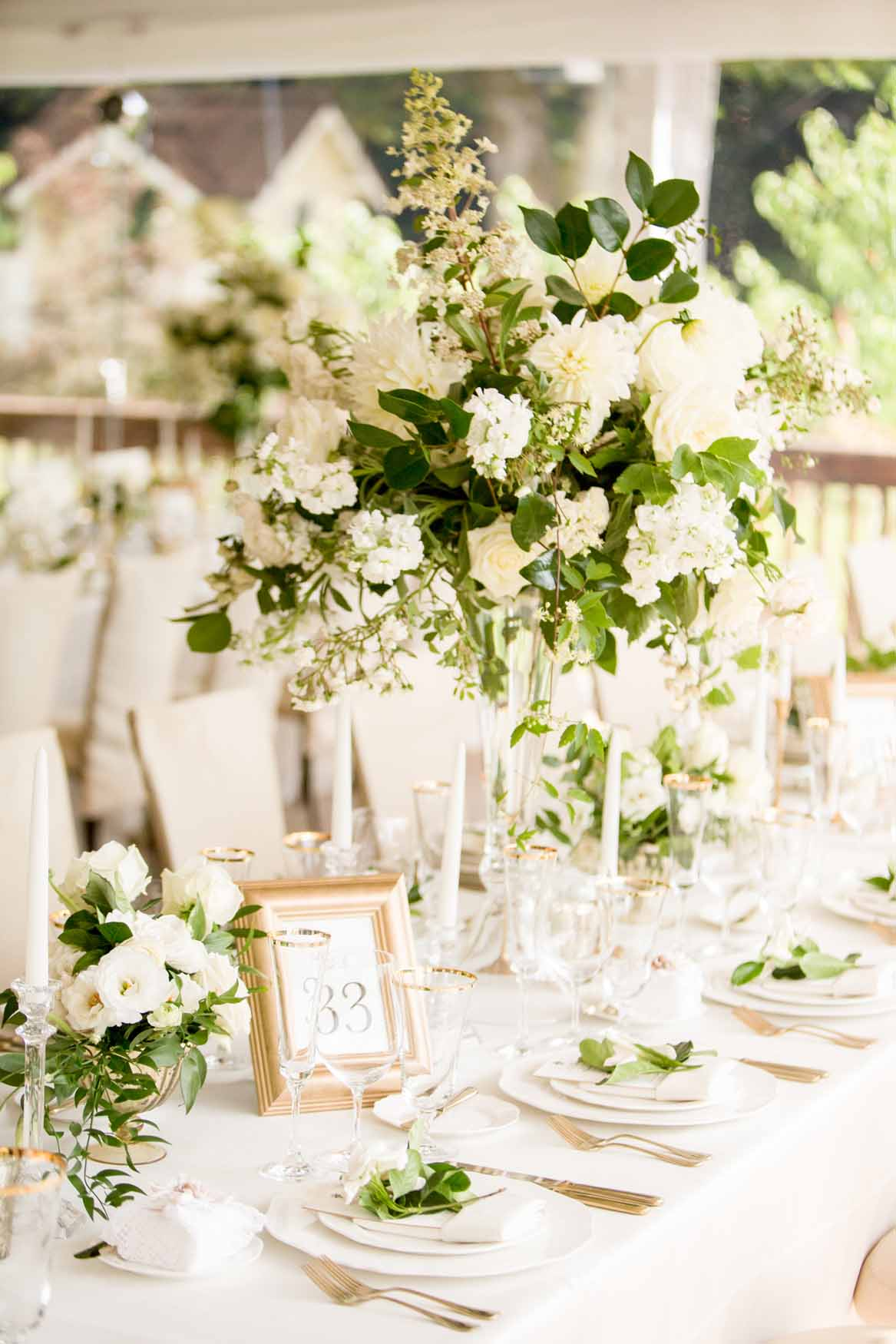 Tall centerpiece of white garden flowers on top of clear crystal vase - Elegant Summer Private Estate Wedding. Flora Nova Design Seattle