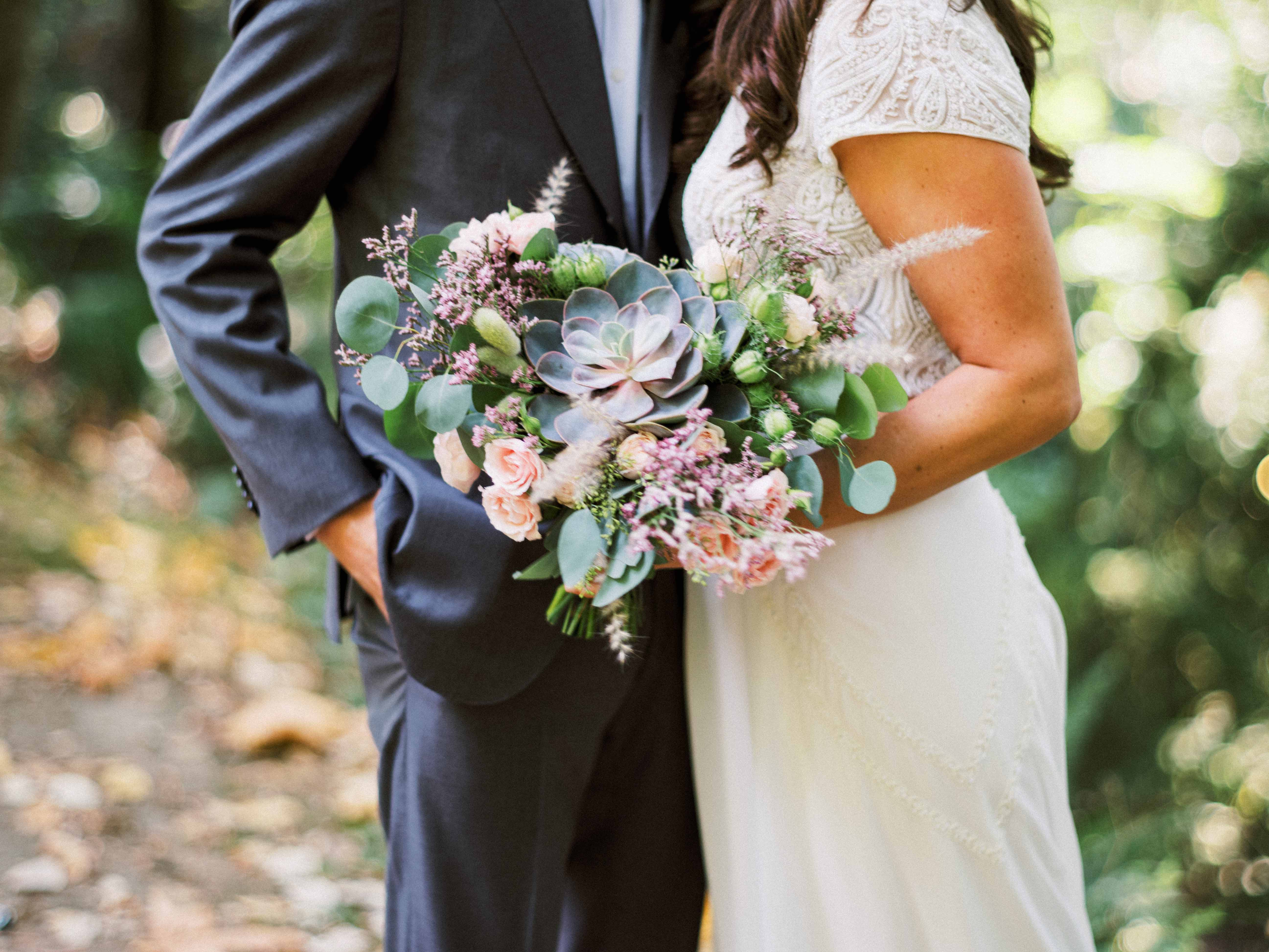 A unique bouquet with a large succulent - Woodmark Hotel Wedding by Flora Nova Design Seattle