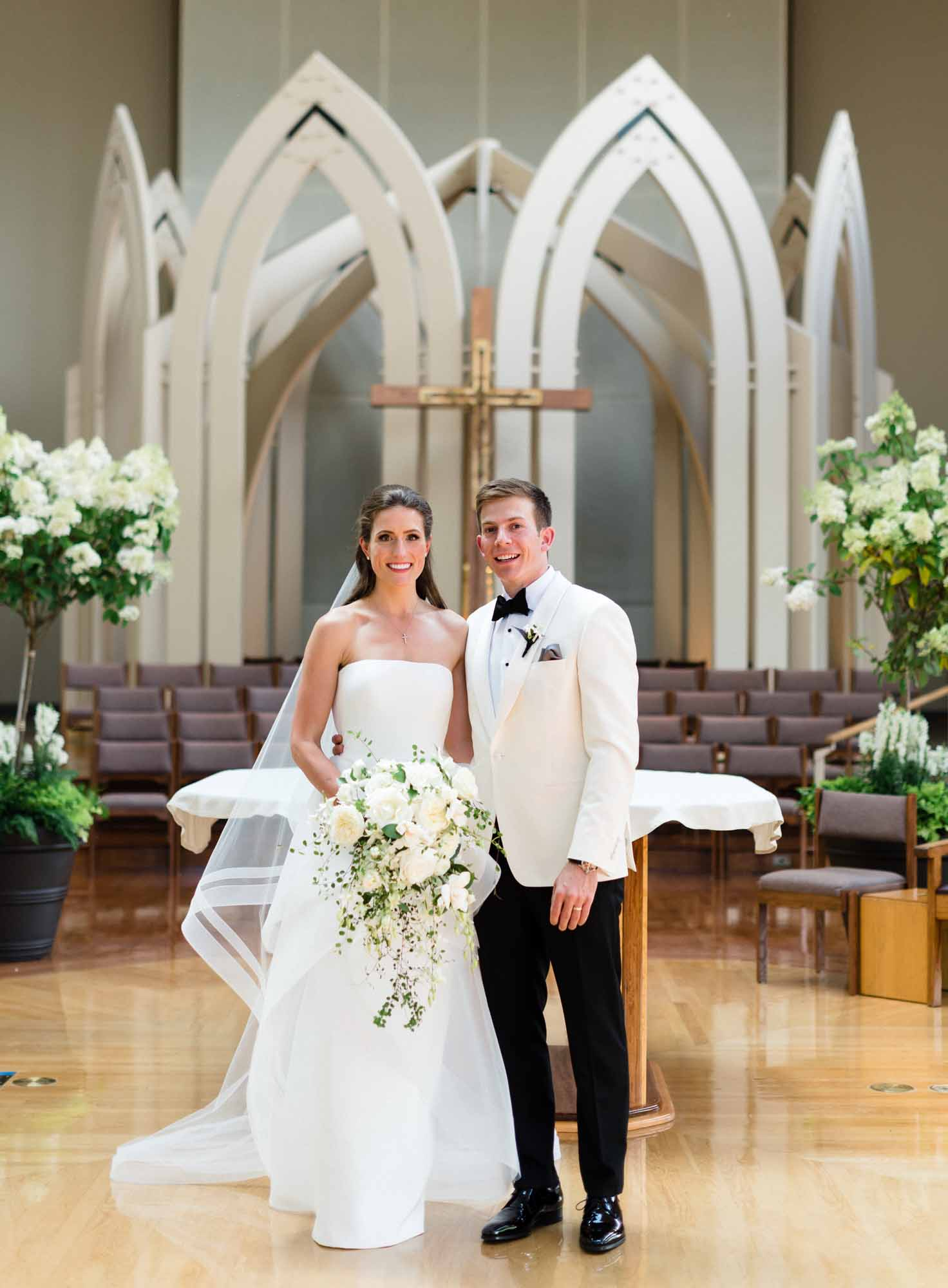 Bride and groom in front of church altar at their wedding
