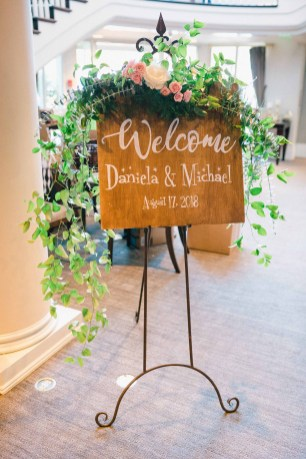 A wooden welcome sign for Daniela and Michael's wedding - Woodmark Hotel Wedding by Flora Nova Design Seattle