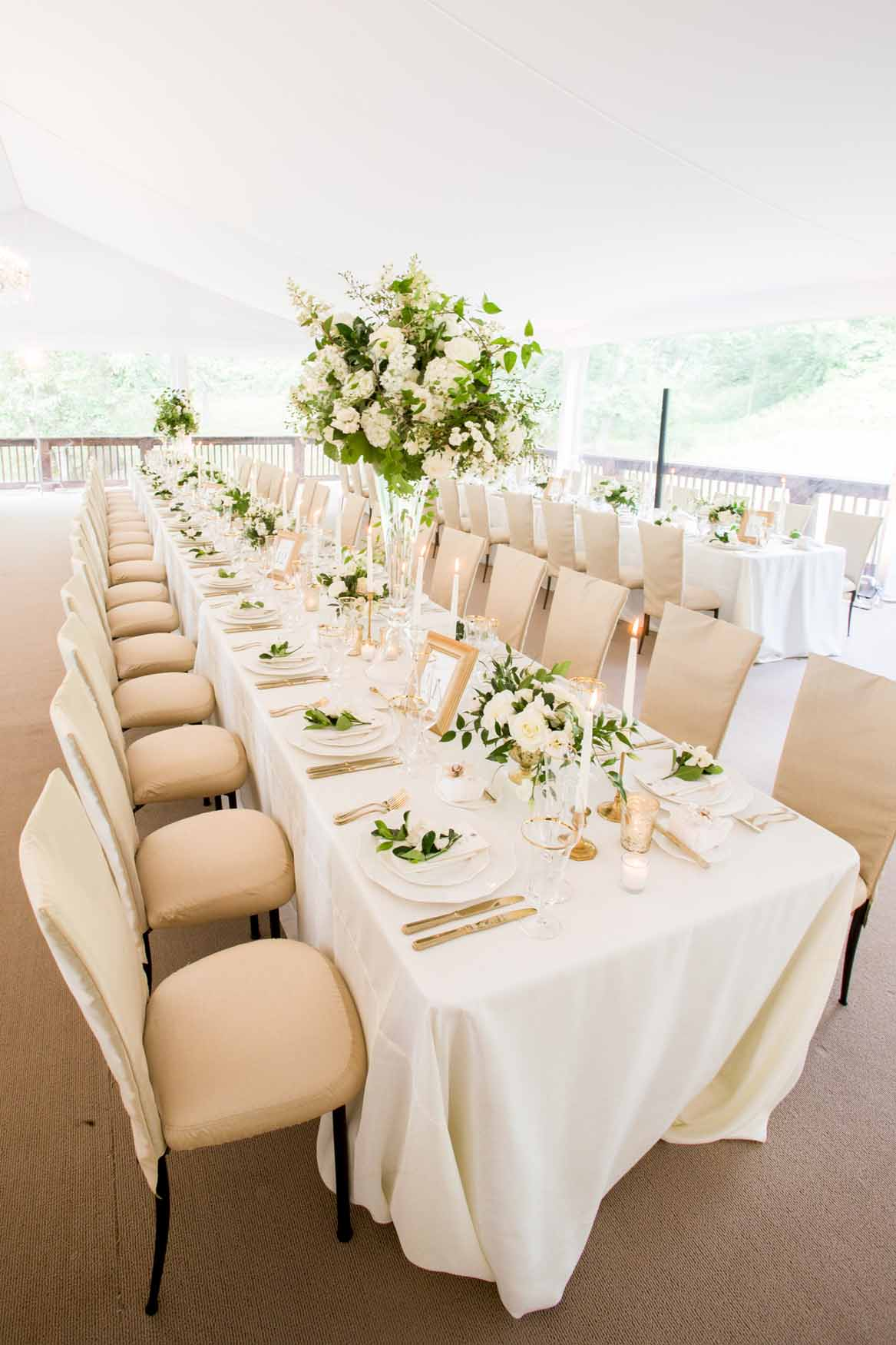 Long tables at wedding reception with tall centerpieces, white flowers - Elegant Summer Private Estate Wedding. Flora Nova Design Seattle