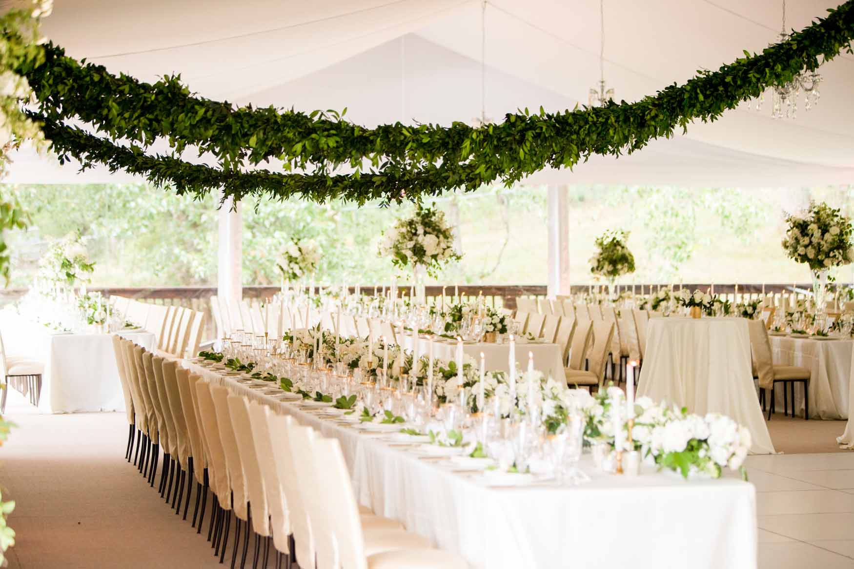 Greenery garlands in wedding tent with long tables - Elegant Summer Private Estate Wedding. Flora Nova Design Seattle